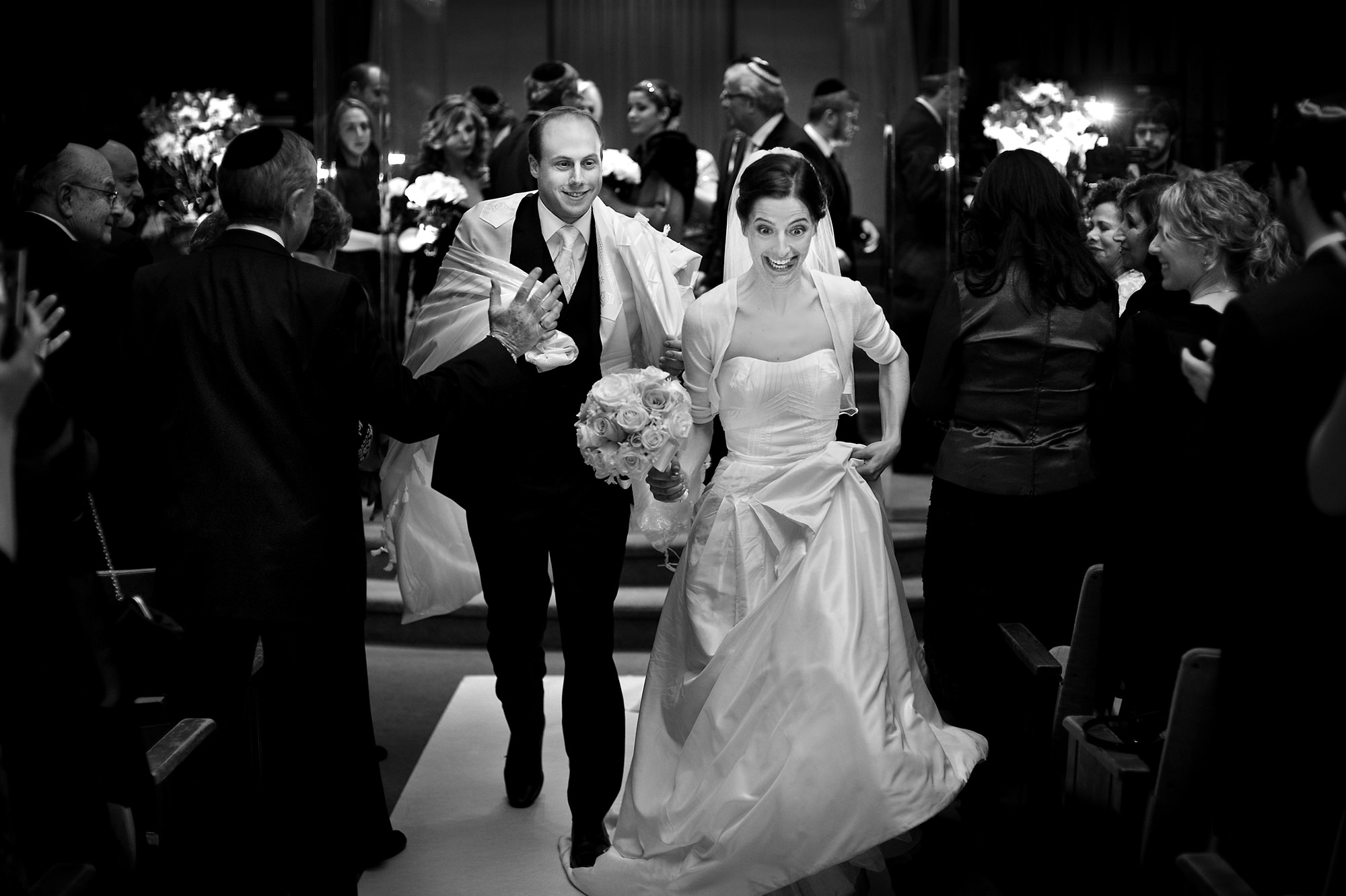 Bride makes funny face walking down aisle - Davina + Daniel