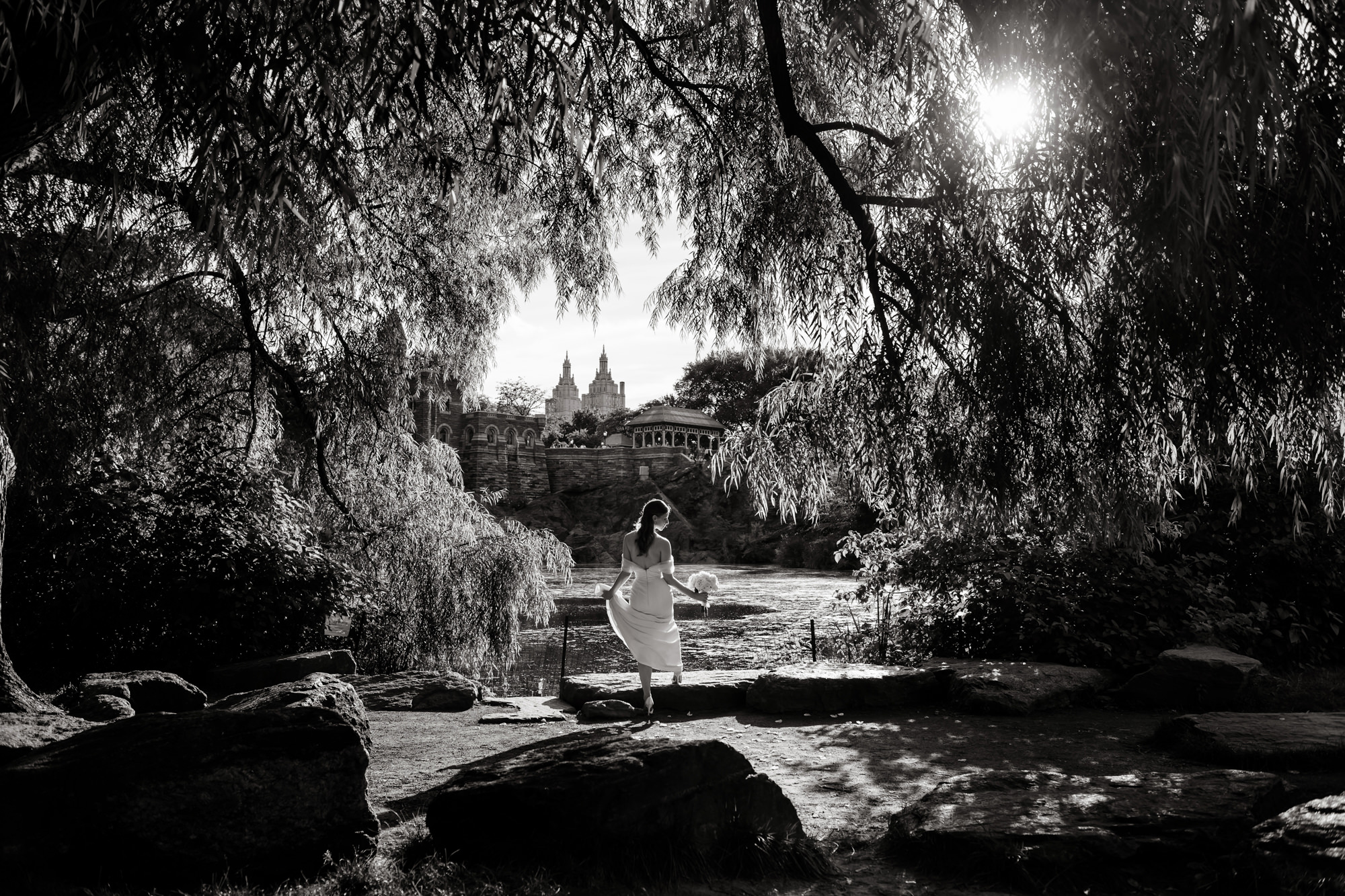 Black and white portrait of bride framed by trees photo by Cliff Mautner