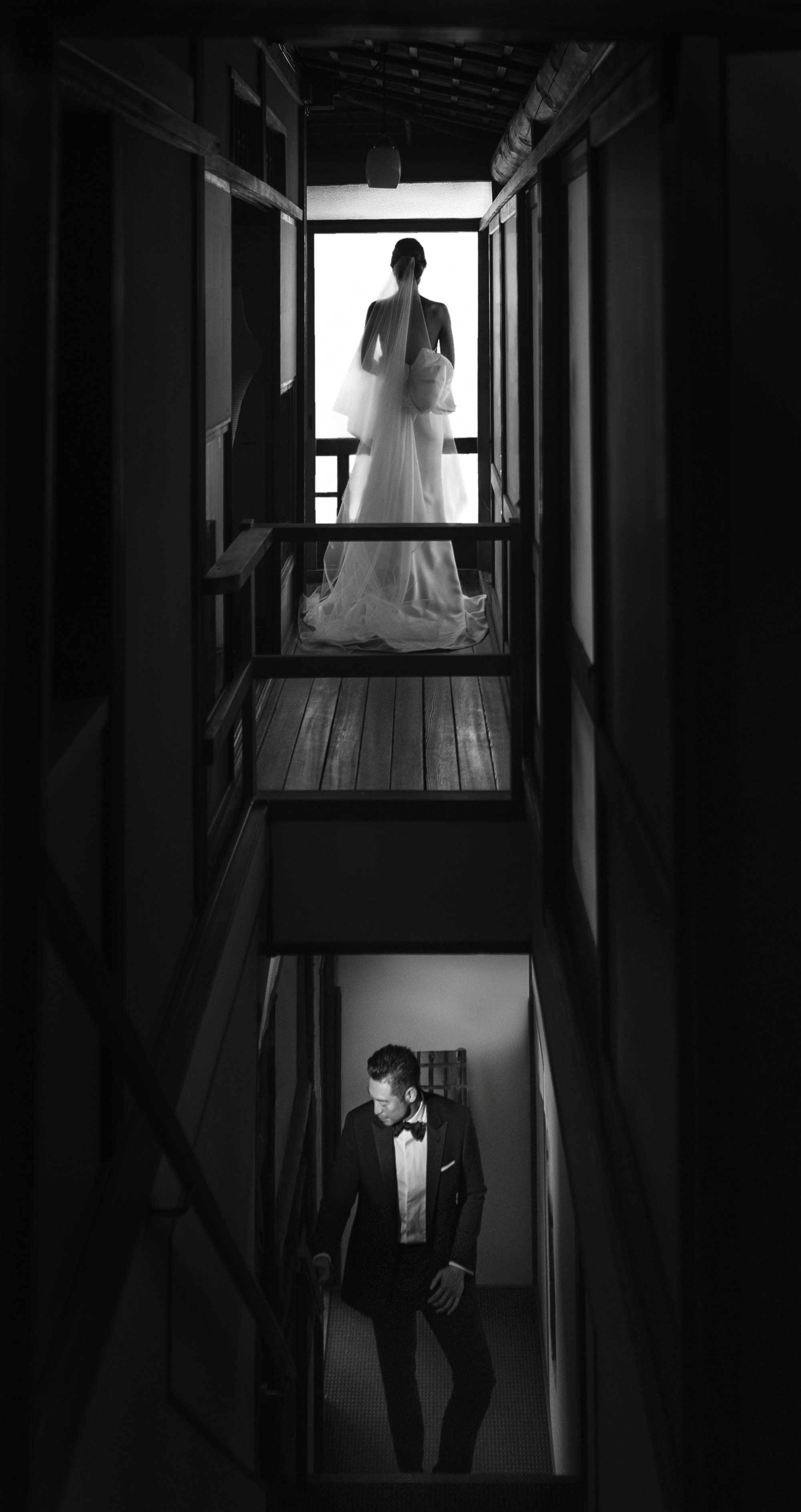 Groom ascending stairs towards bride on balcony  -  photo by 37 Frames - Japa