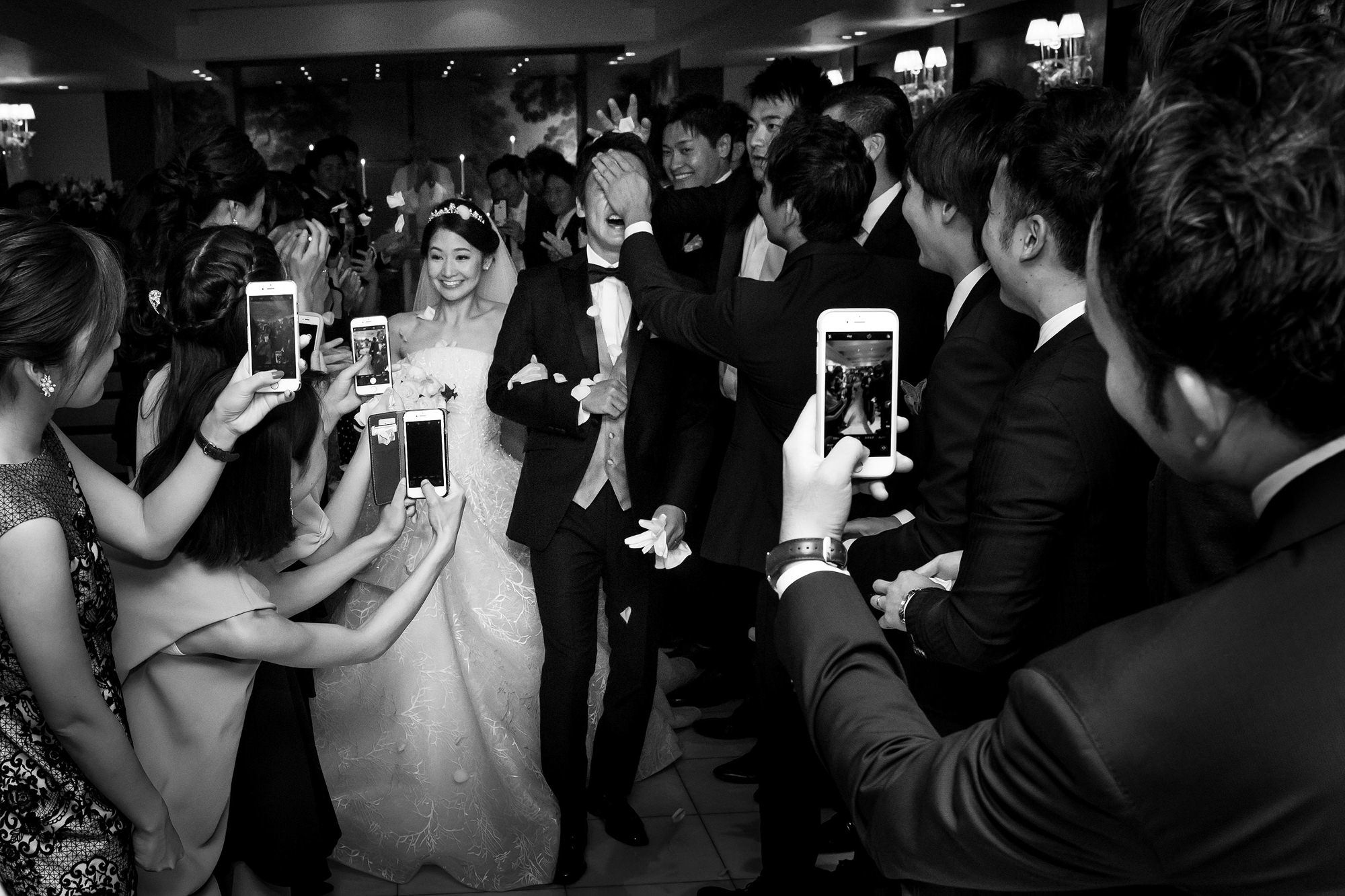 Guests rush to take photos of just married couple - photo by 37 Frames - Japan