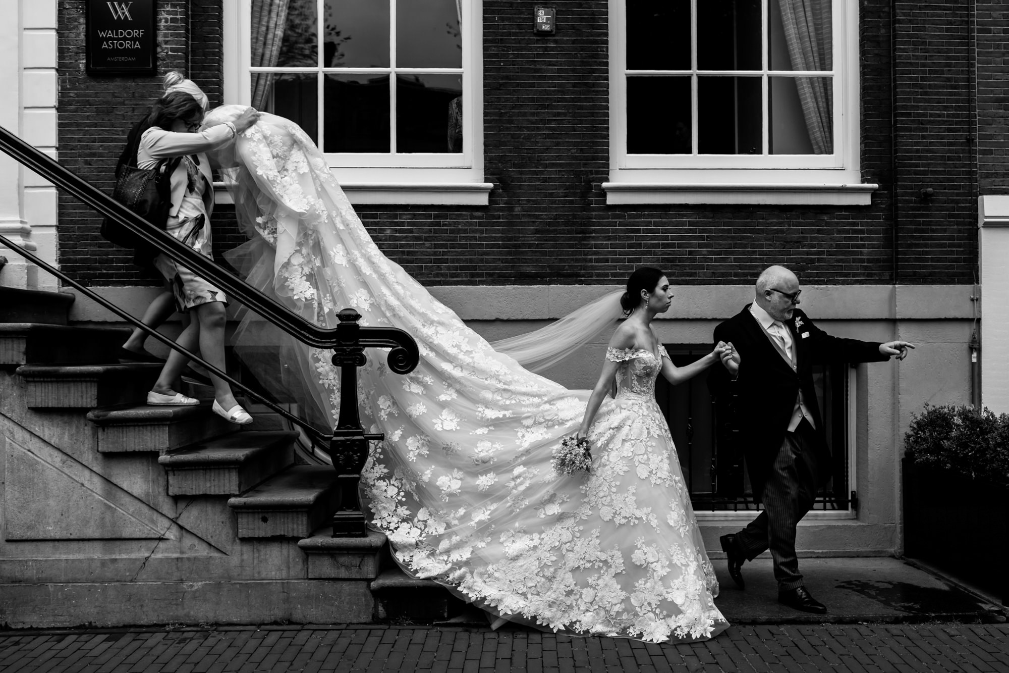 Father leading bride in grand cathedral gown photo by Fotobelle: Isabelle Hattink