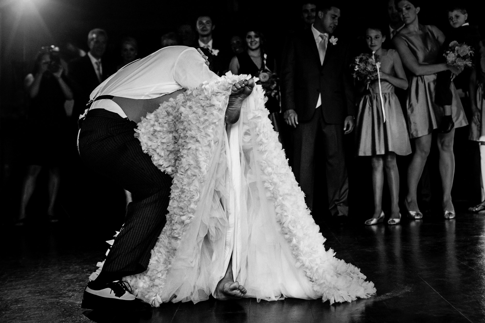 Groom dipping and kissing bride on dance floor - photo by JAG Photos