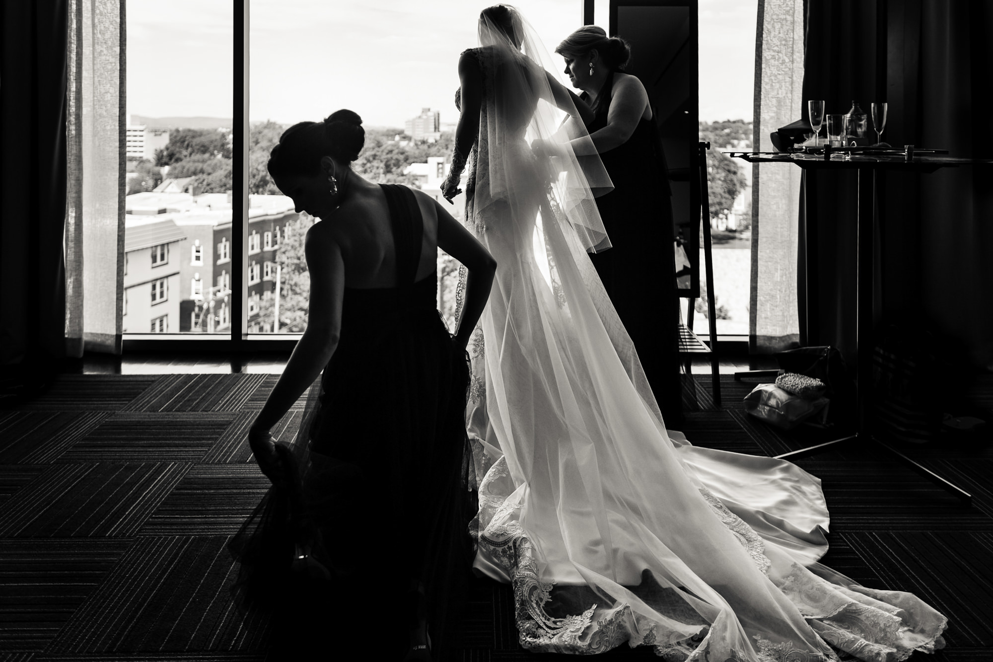 Bride in dramatic veil and gown getting ready - photo by JAG Studios