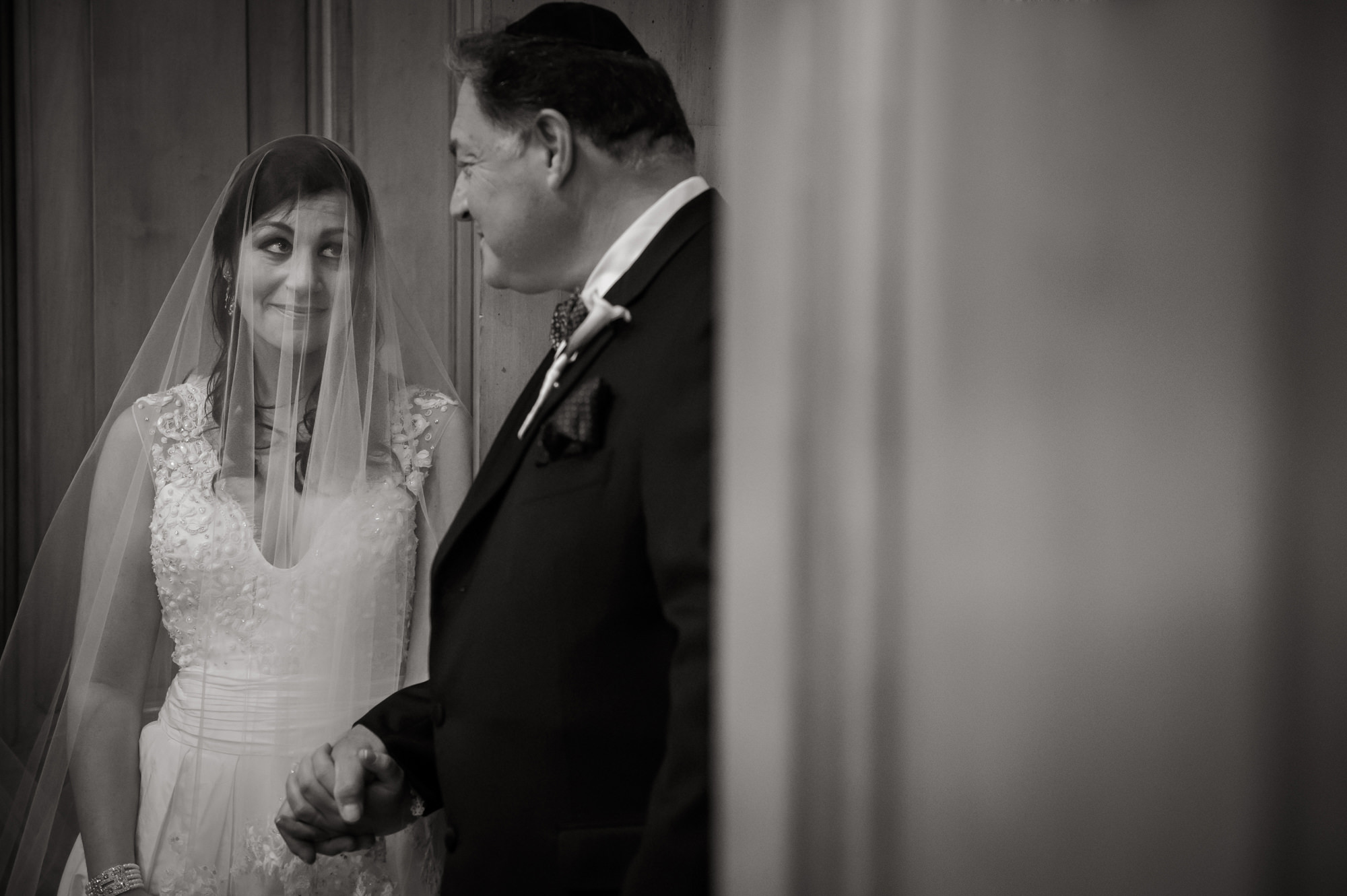 Bride and dad look at each other right before processional, by Cliff Mautner