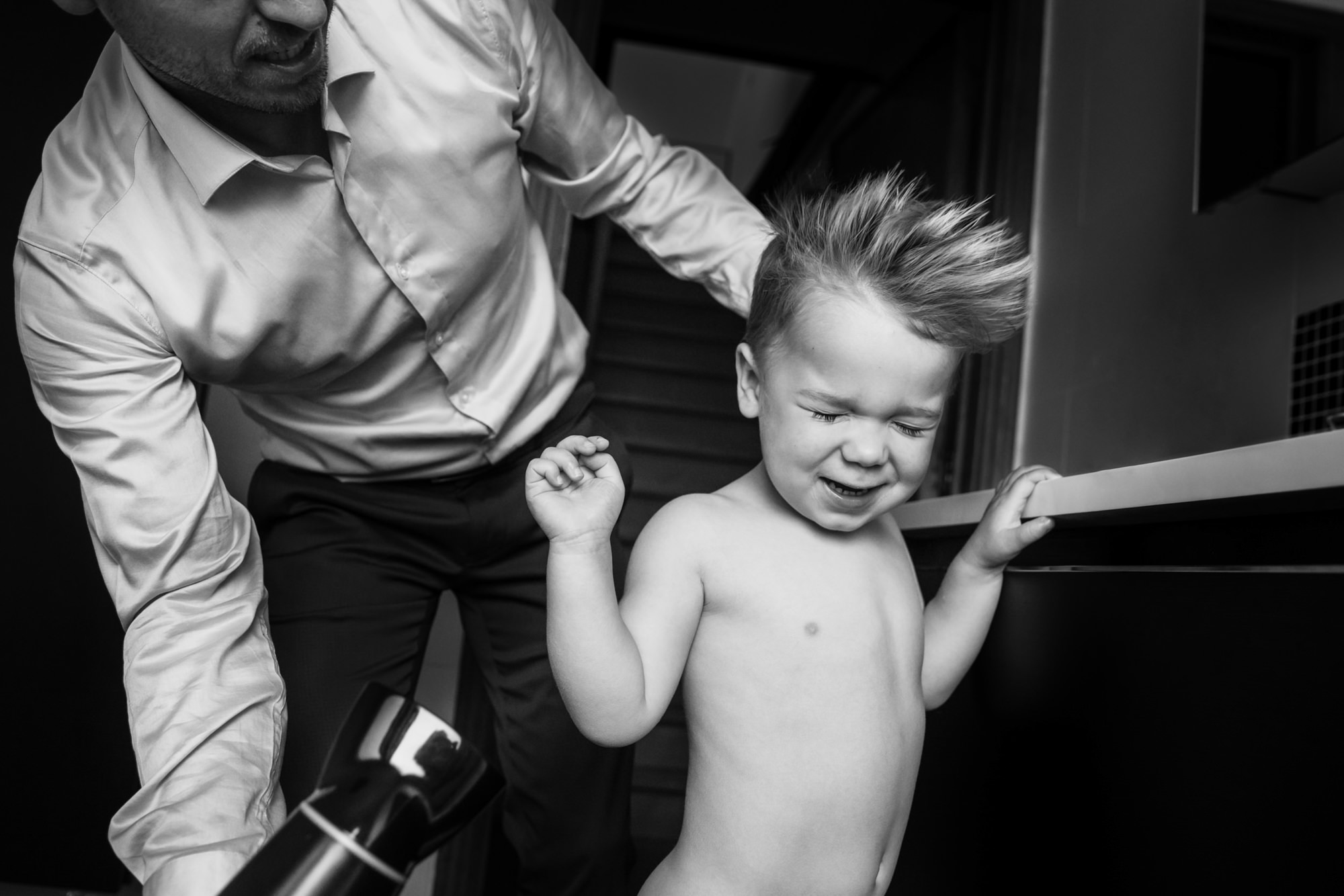 Photo of little boy getting his hair dried by Phillipe Swiggers