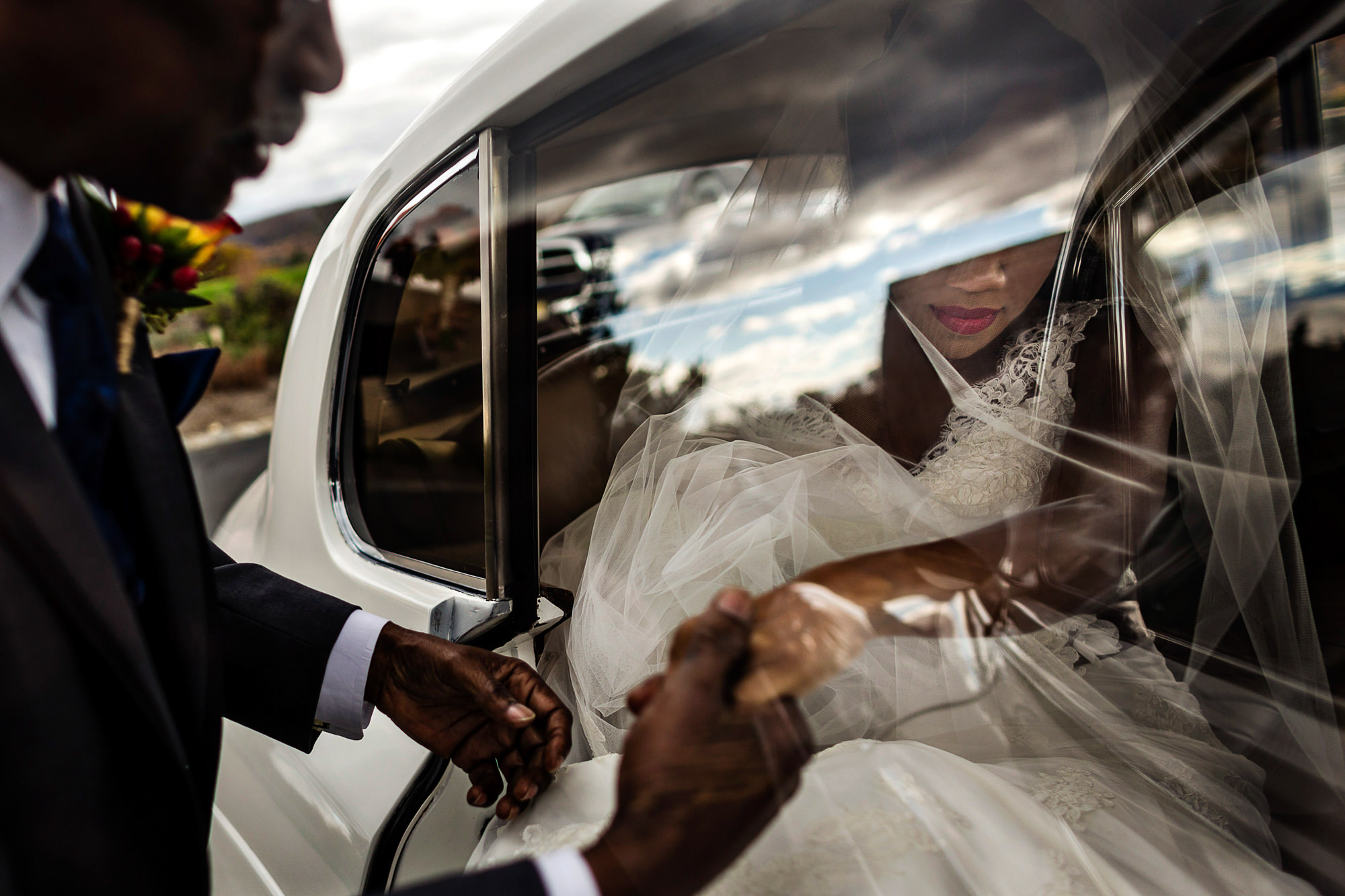 Bride and groom exiting limo - photo by JAG Studios