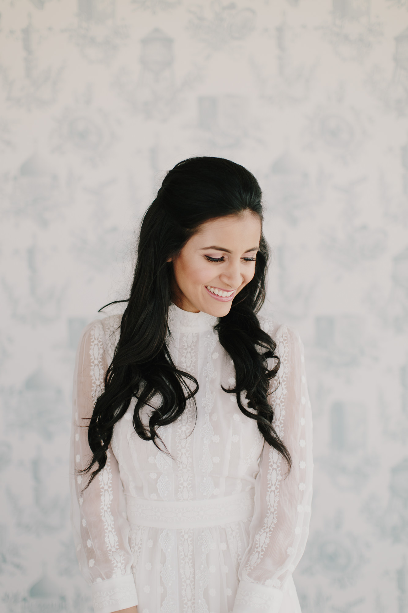 Portrait of bride with high-neck modest lace dress by James Moes
