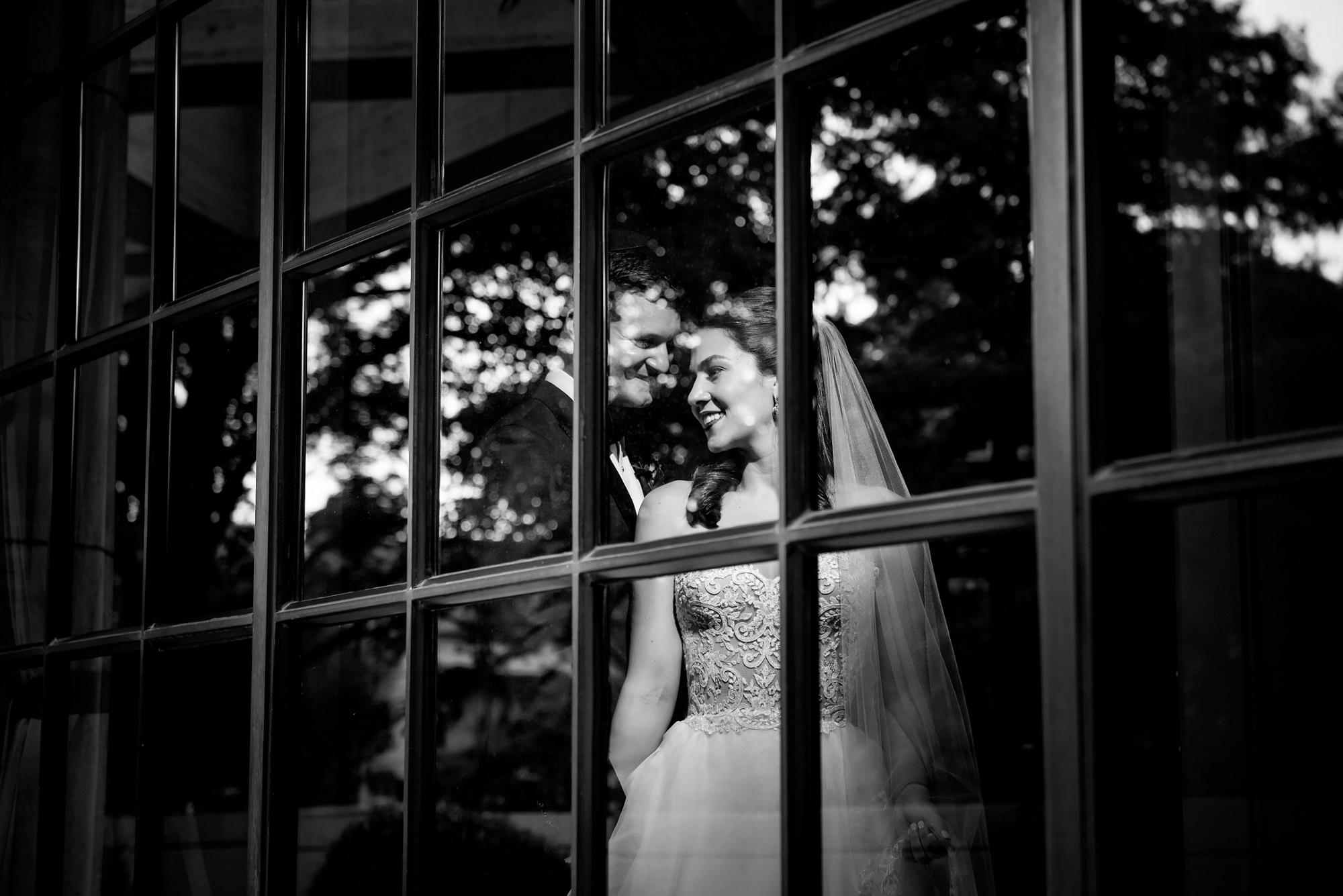 Couple seen through window - Morgan Lynn Photography