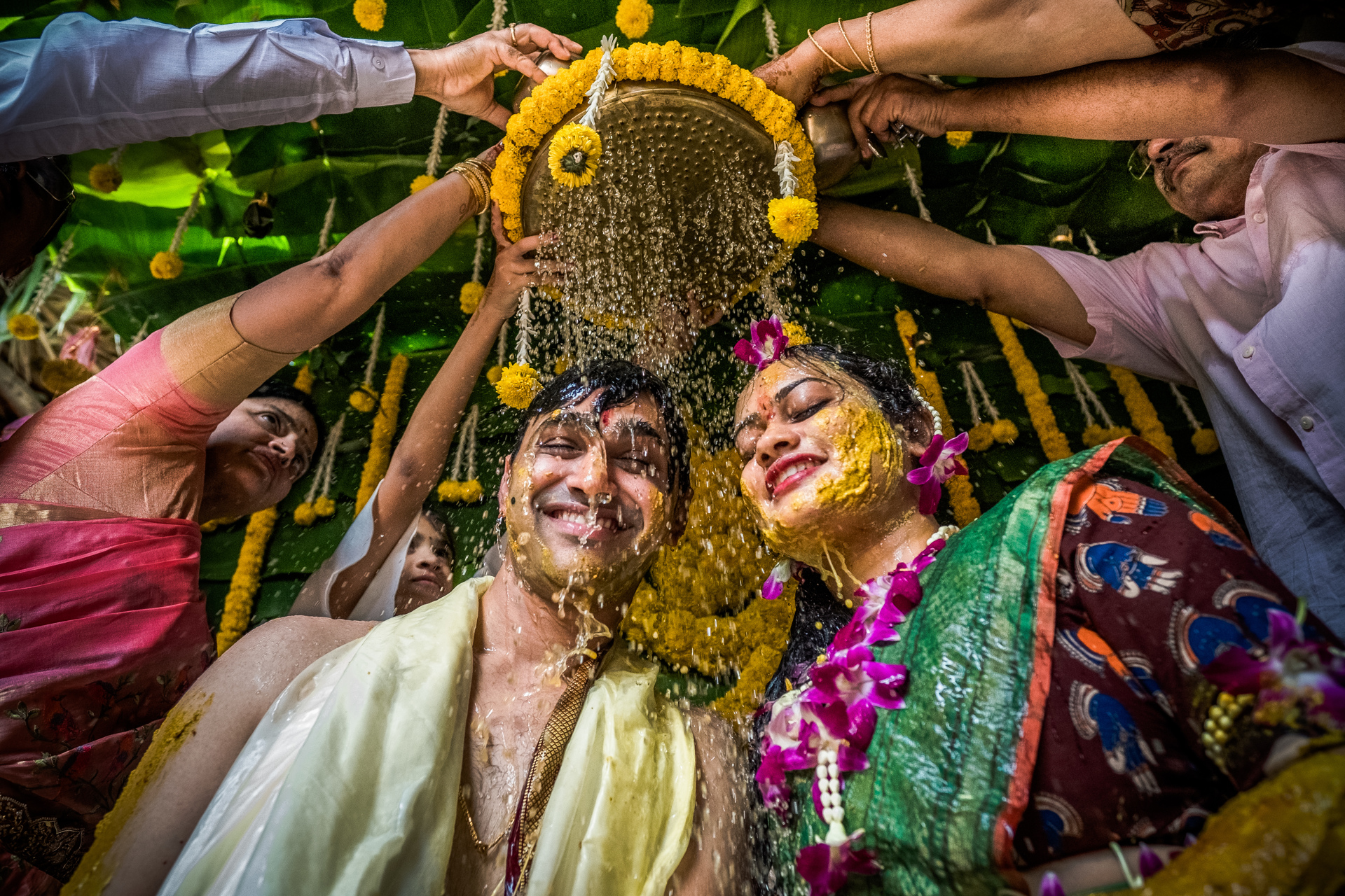Indian couple showered with water after saffron ceremony - photo  by Sephi Bergerson