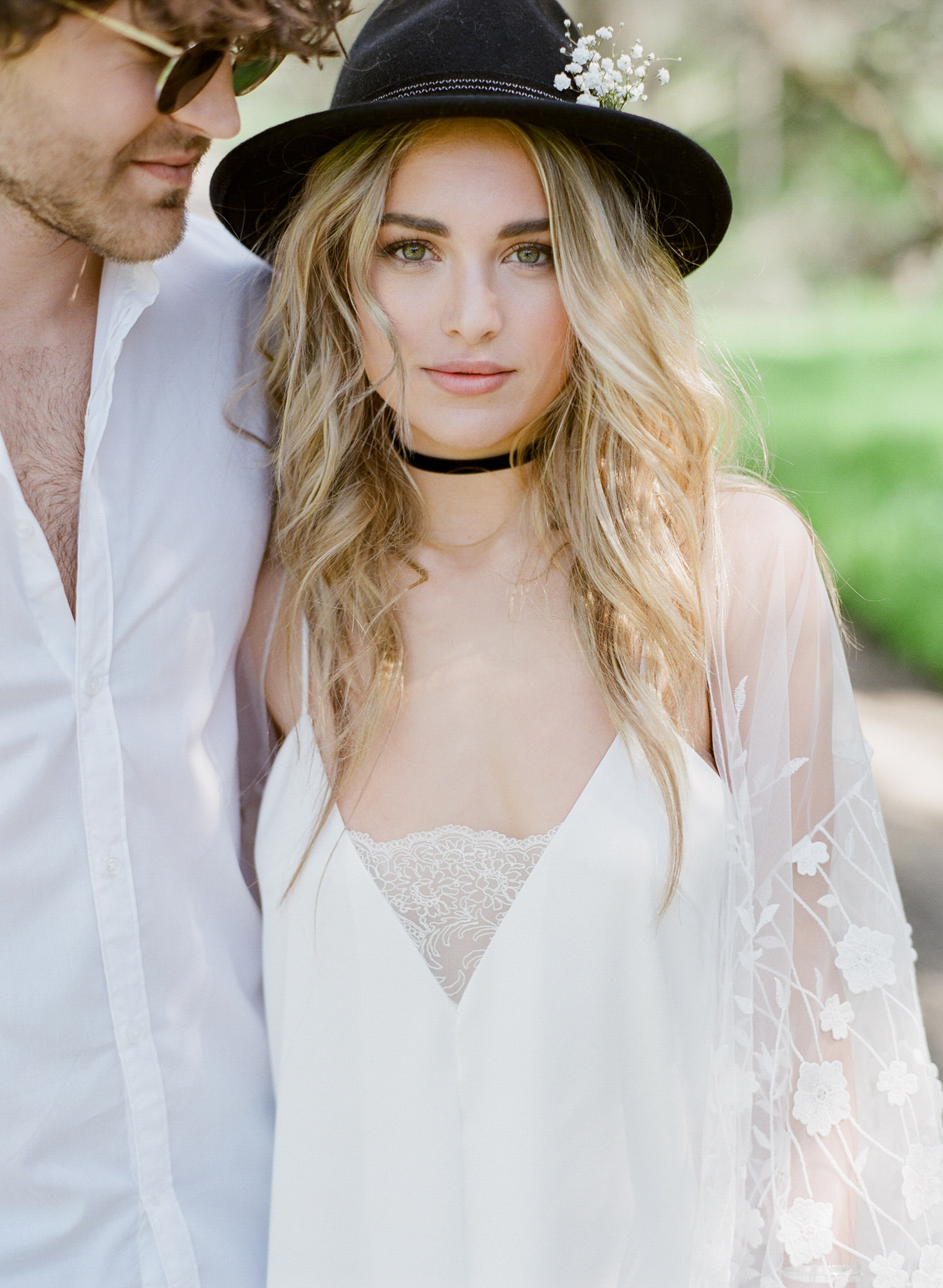 Bride in felt hat with long curls and boho dress - Greg Finck Photography
