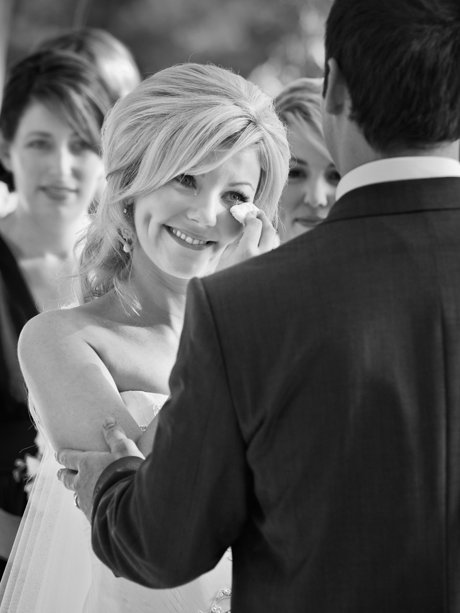 Bride wiping away tears of joy - Studio Impressions Photography