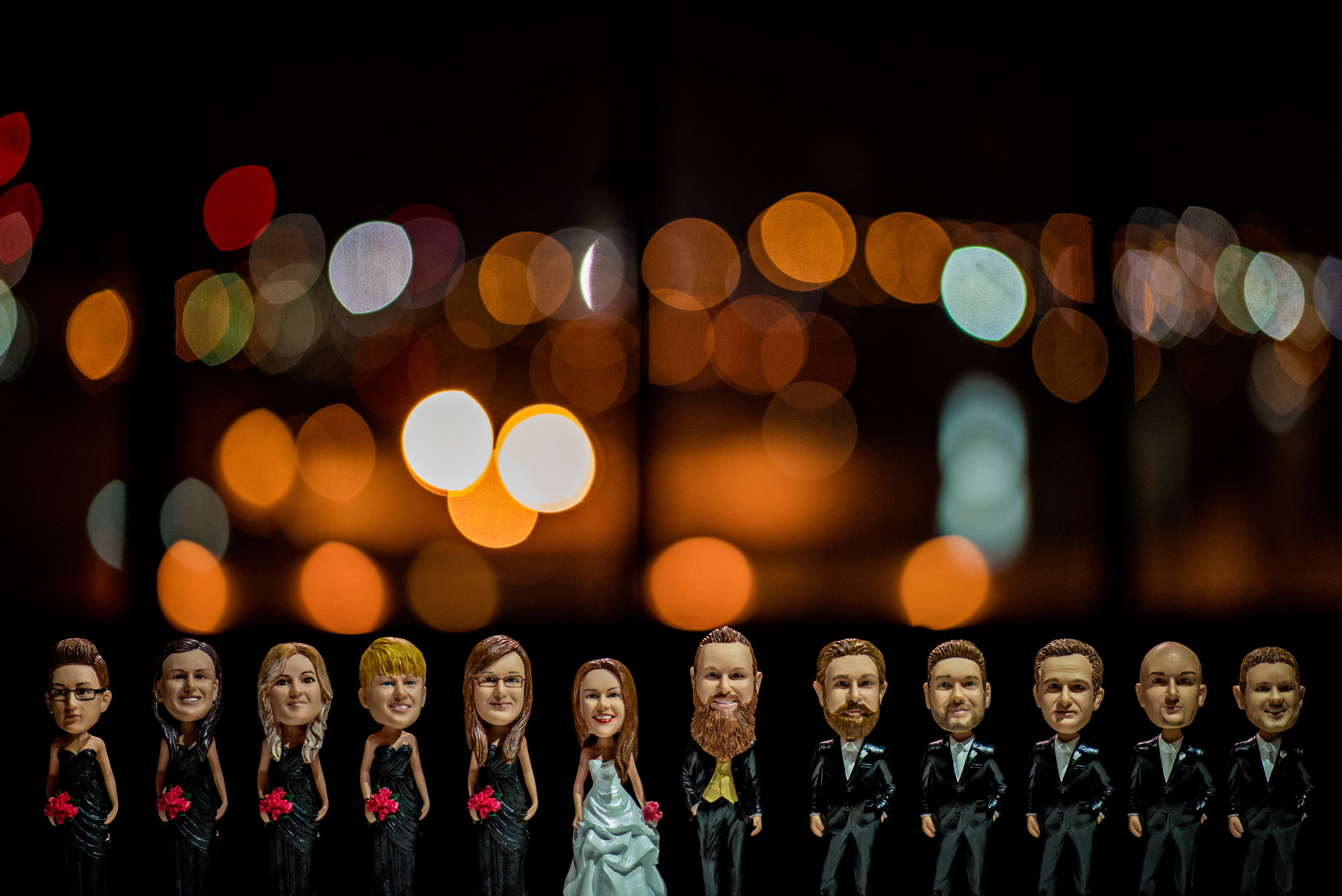 Bobble heads of bride, groom and bridal party - photo by Cooked Photography