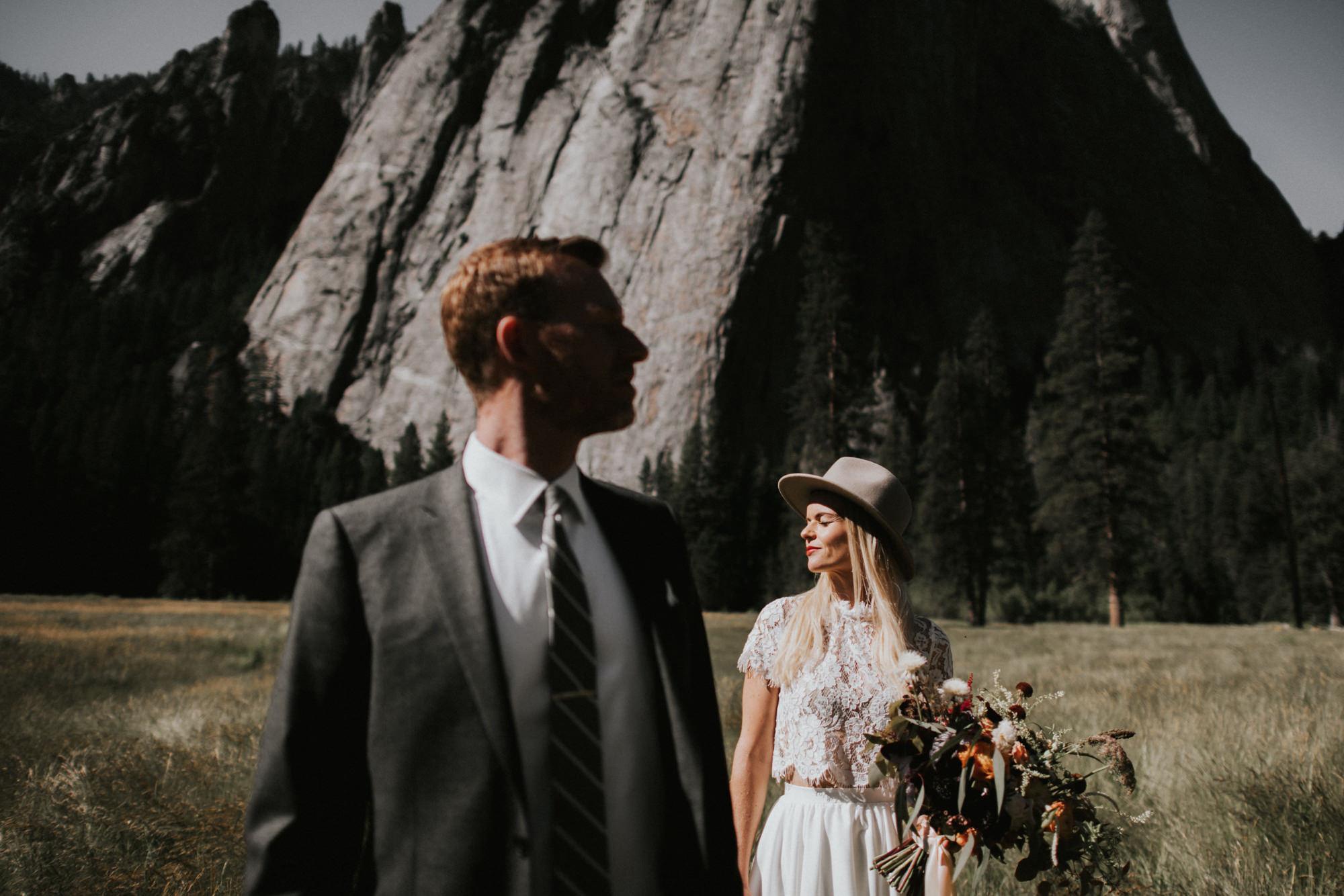 Couple in mountain field - Nick + Danee