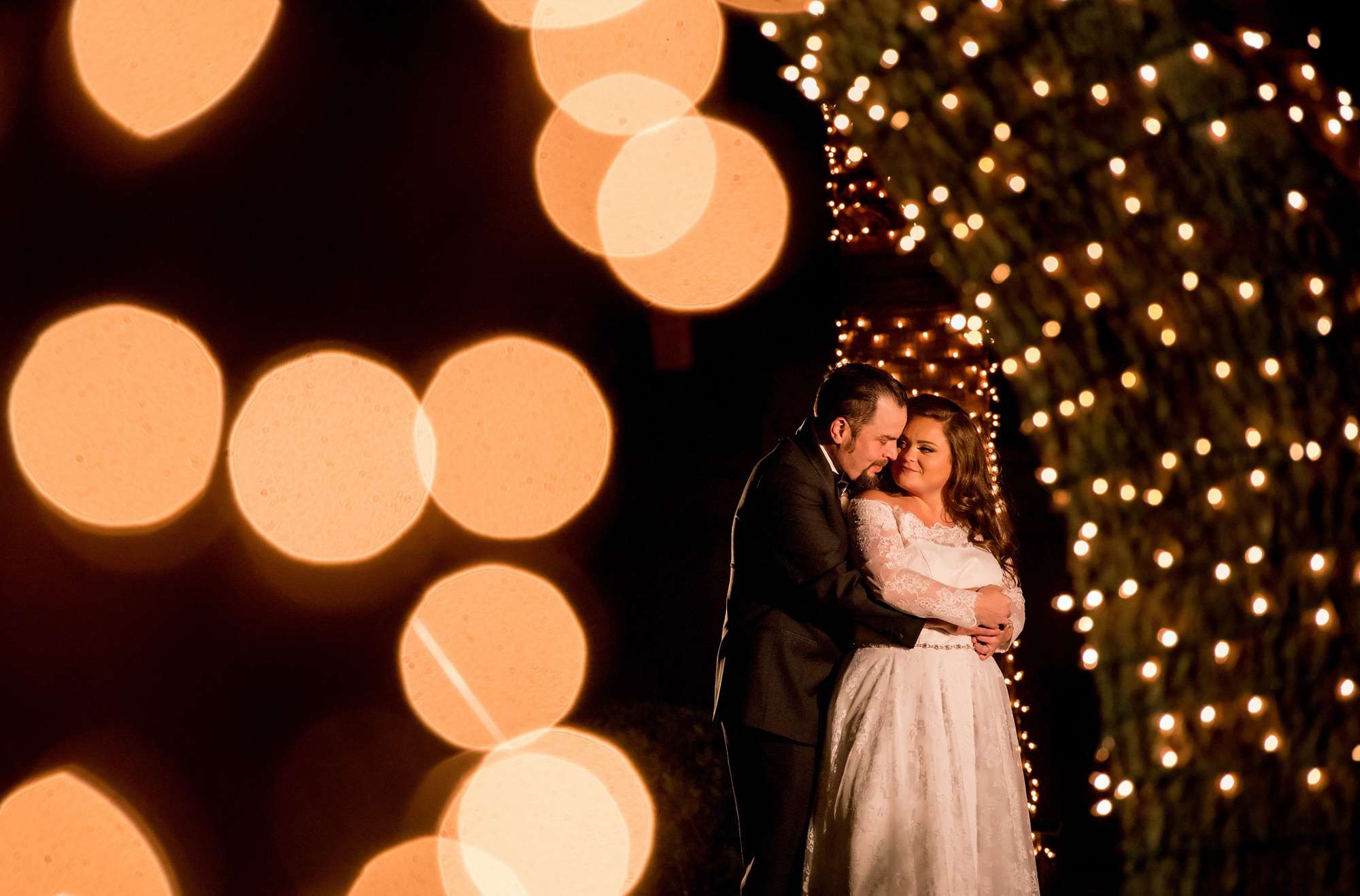 Bokeh lights surround wedding couple - Morgan Lynn photography