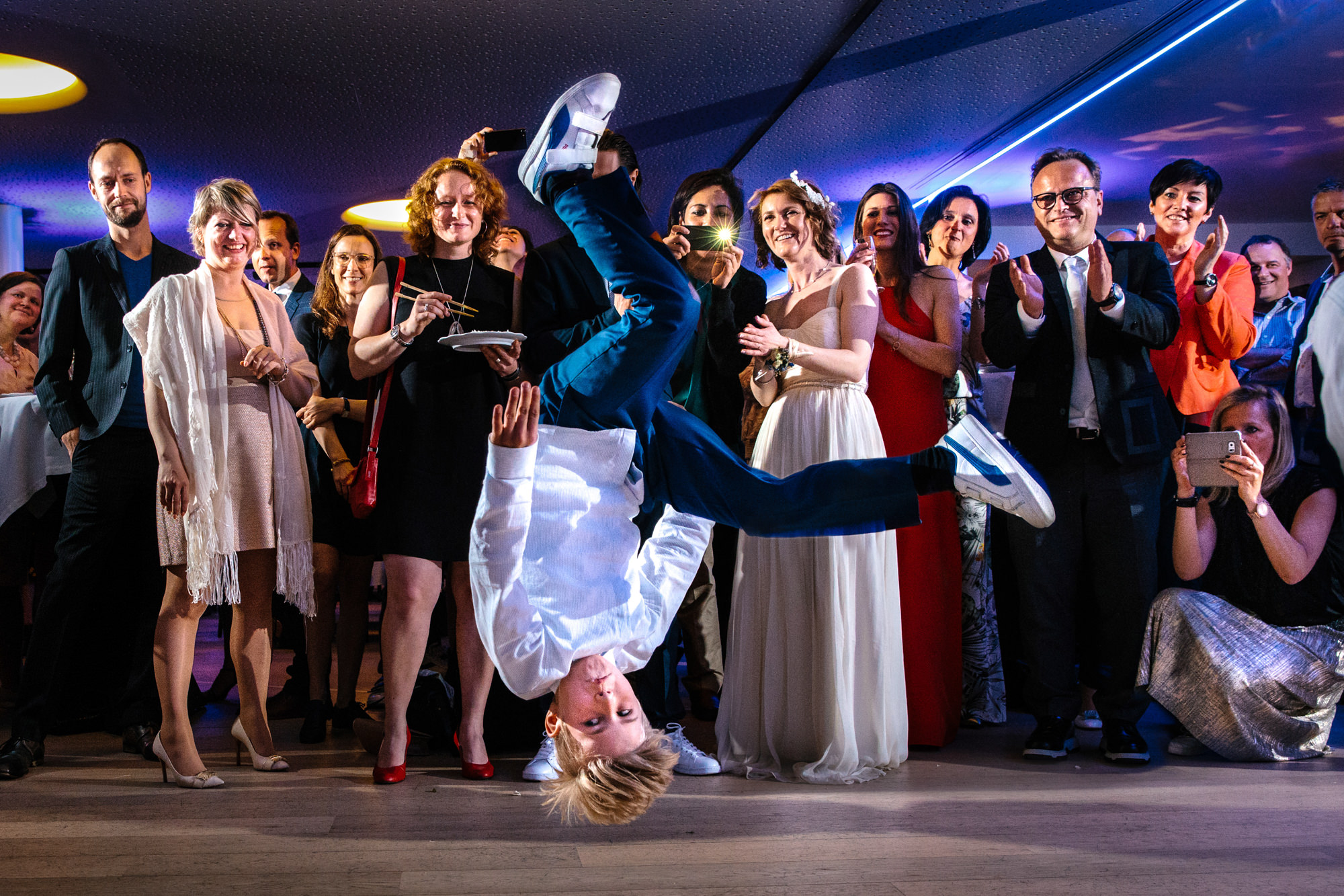 Boy breakdancing at reception photo by Yves Schepers