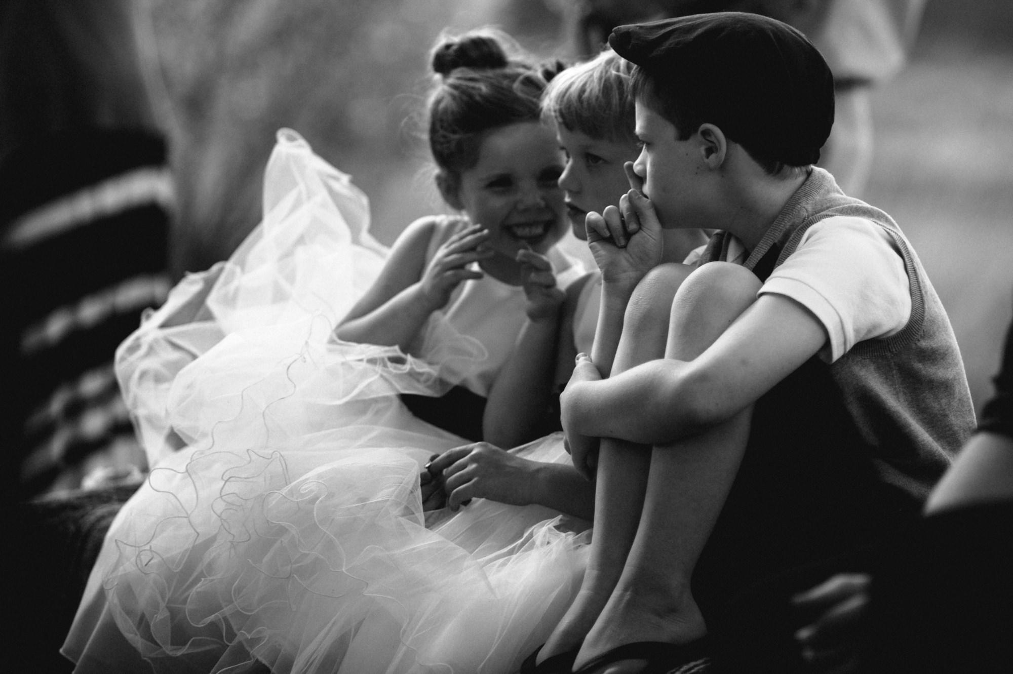 Boy shushes girl at wedding - photo by Kristen Marie Parker