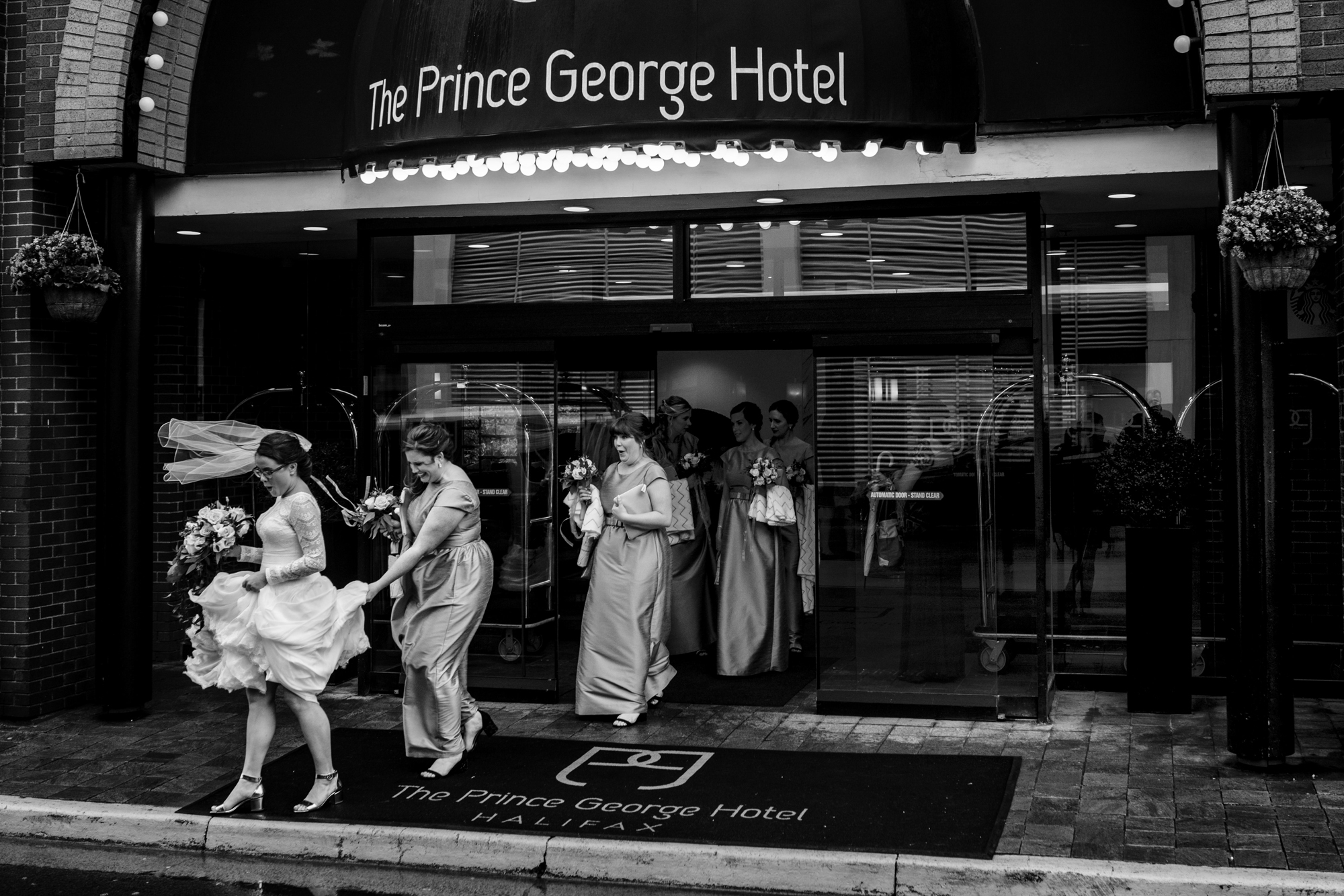 Bridal party leaving The Prince George Hotel - photo by Cooked Photography