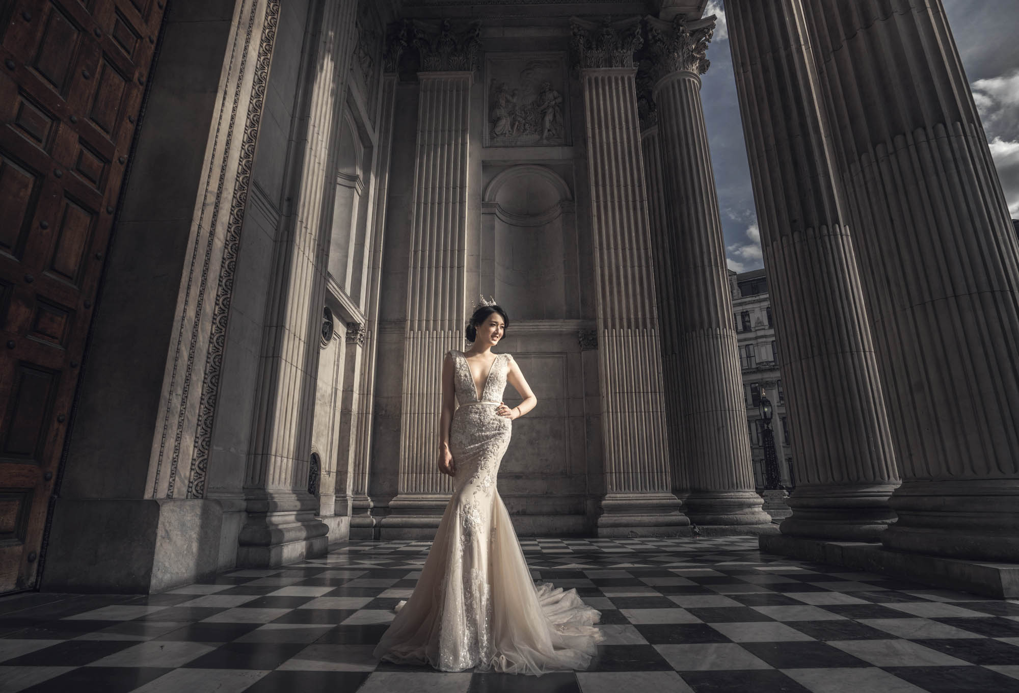 Bride in beautiful plunging neckline gown in palatial setting, by CM Leung