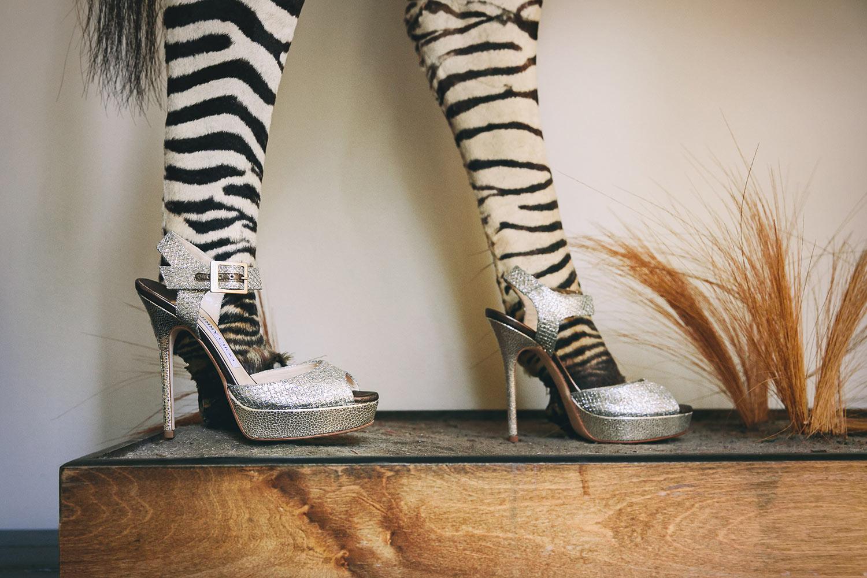 Fun photo of zebra legs in bride heels by Callaway Gable