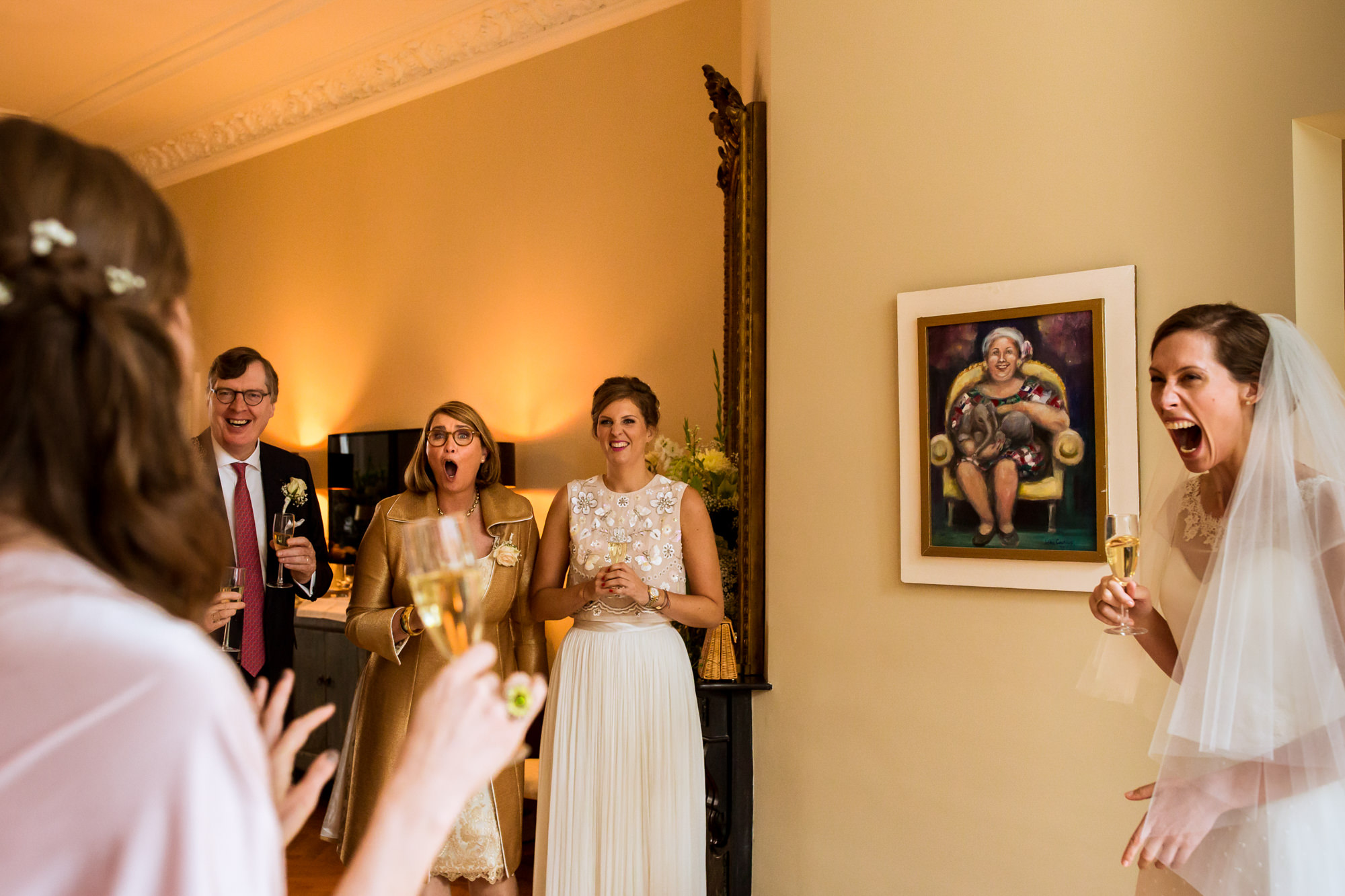 Bride and family react to speech photo by Fotobelle: Isabelle Hattink