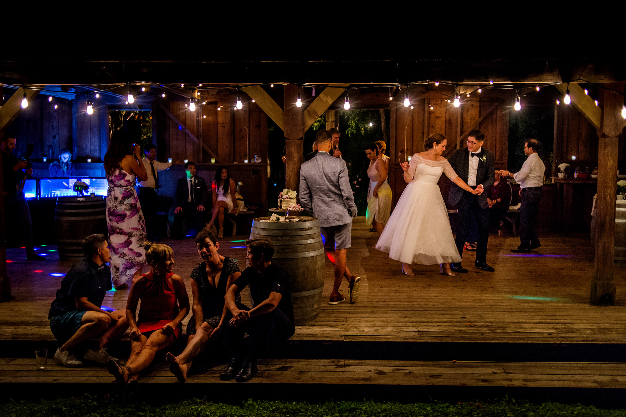 Couple dancing with guests in foreground - Davina + Daniel
