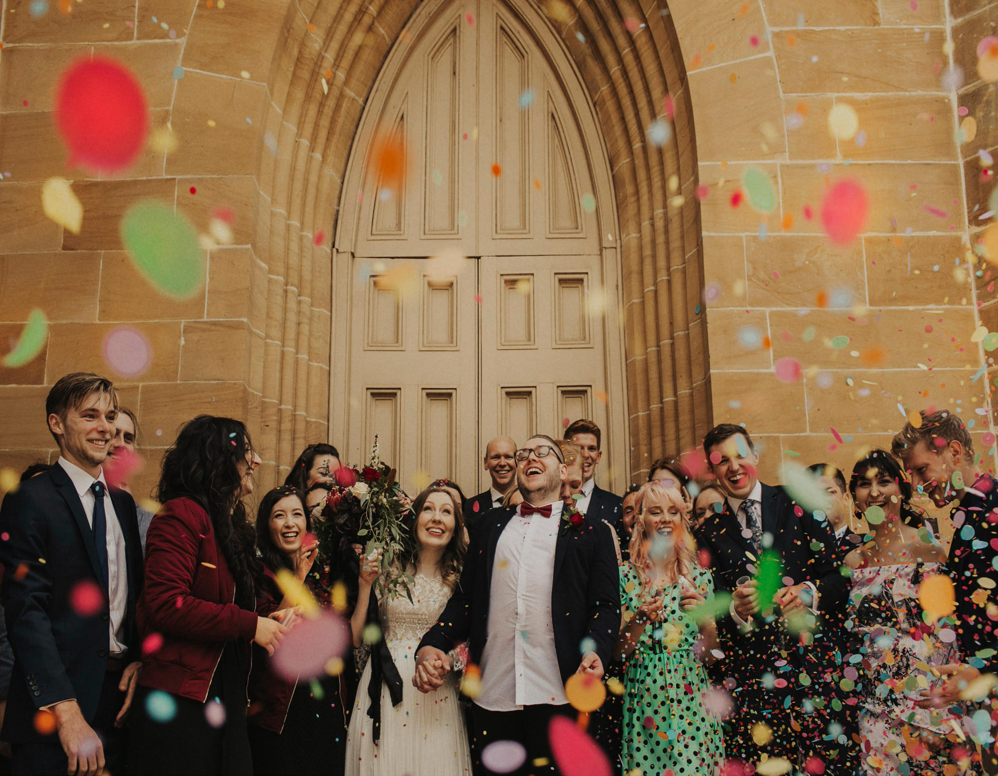 Bride and groom have colorful confetti exit - photo by Dan O'Day