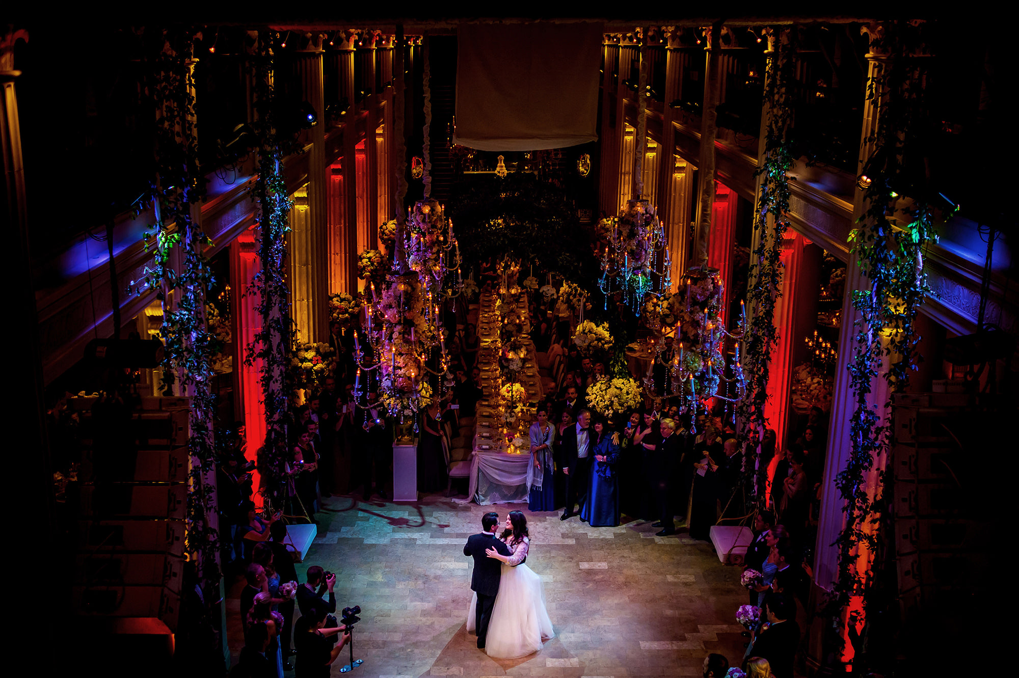 Couple's first dance in a luxurious, colorful reception setting, by Davina Plus Daniel