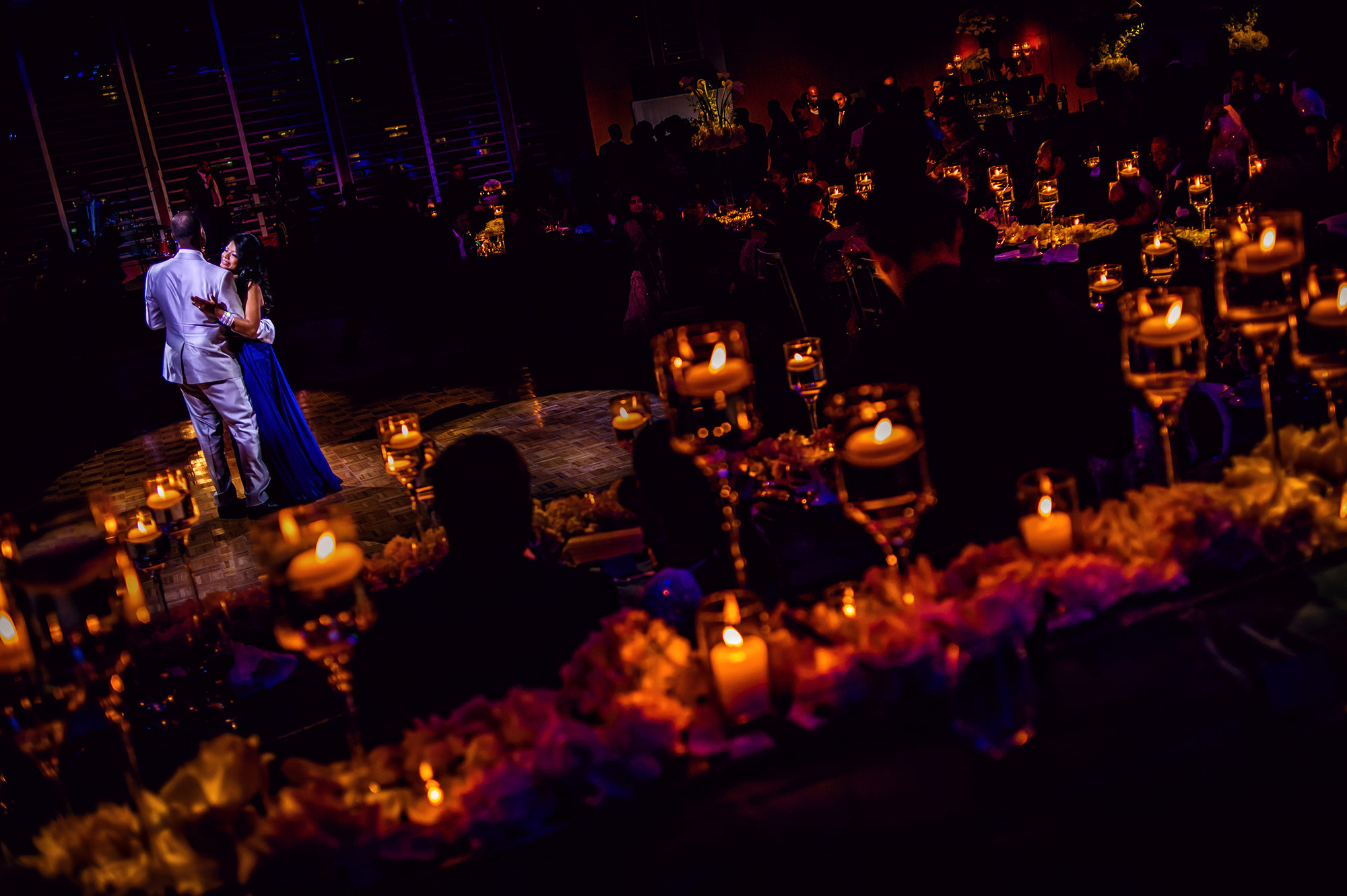 Couple's first dance in candelight and moody reception decor, by Davina Plus Daniel