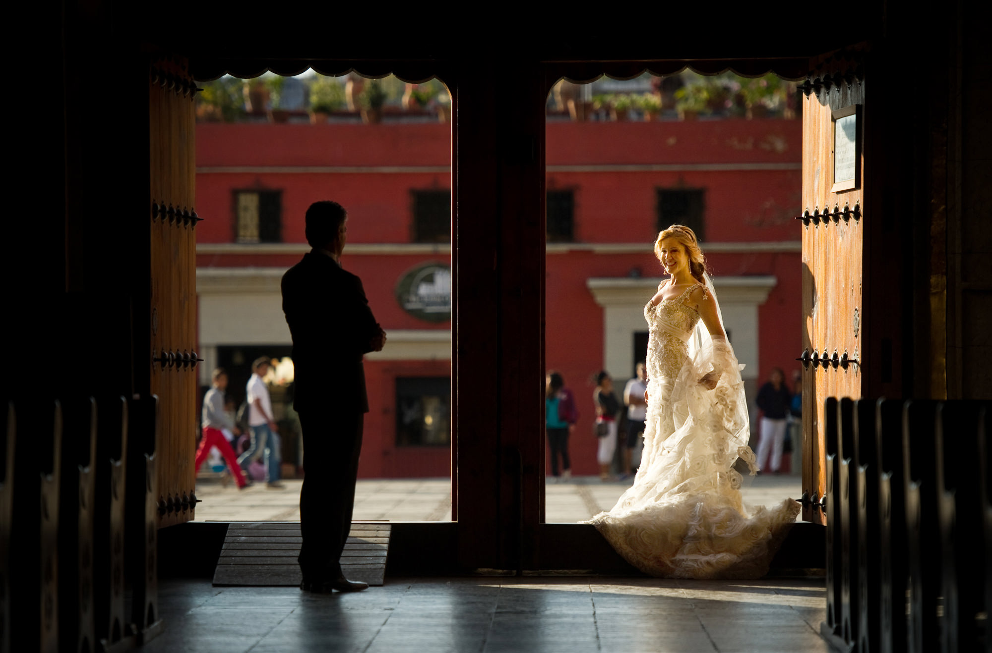 First look of bride and groom framed by double doorways, by Cliff Mautner