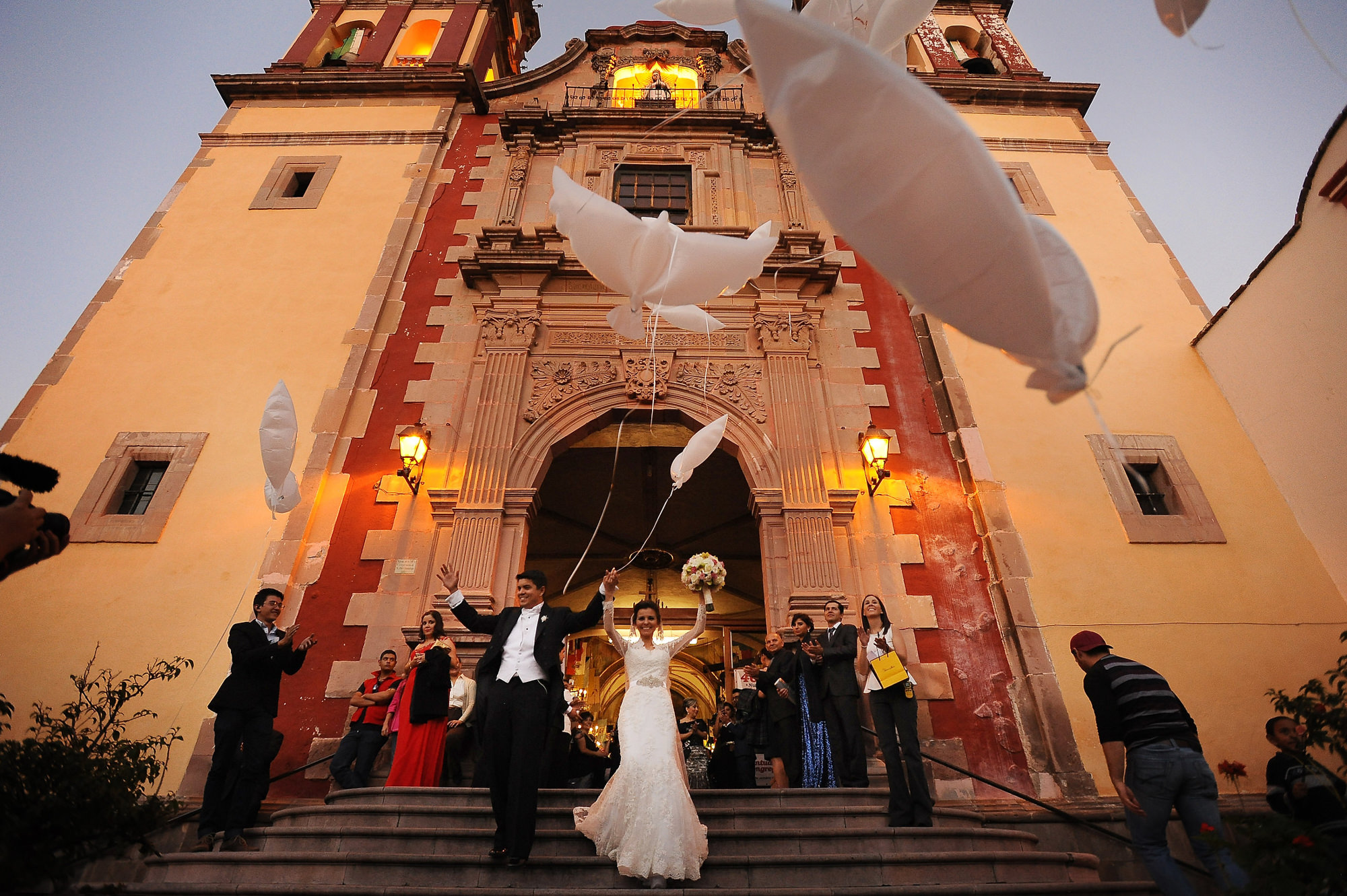 Just married at Spanish cathedral with white kites -  Daniel Aguilar Photographer