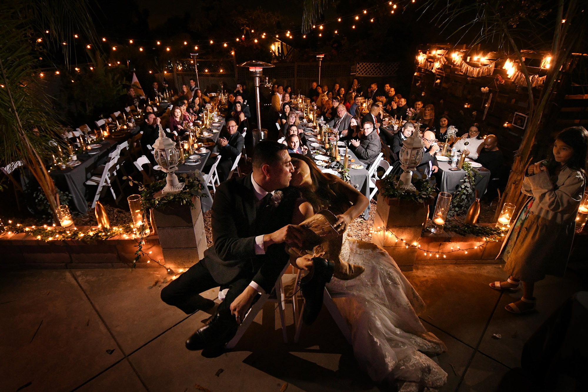 Bride and groom kissing over game - photo by Daniel Aguilar