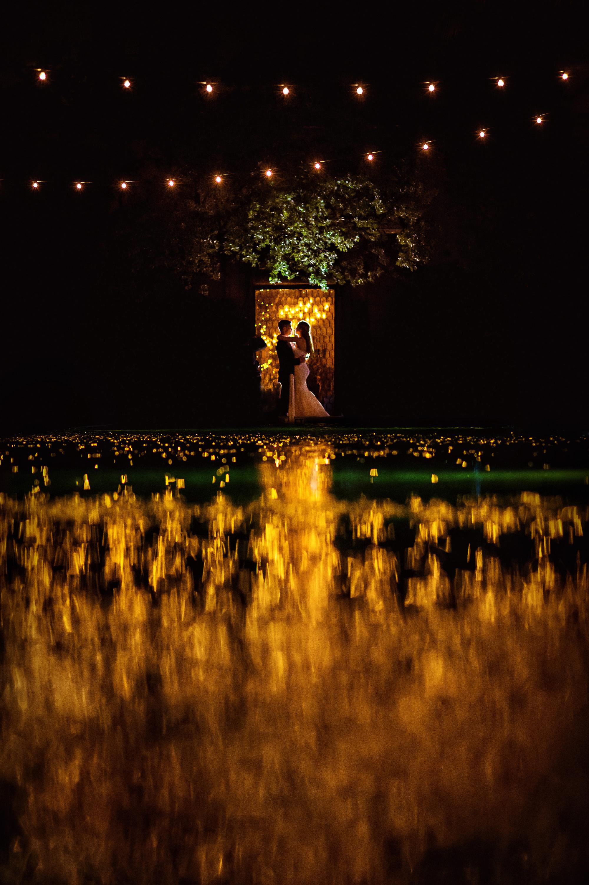 Bride and groom in romantic lit doorway shot, by Davina Plus Daniel