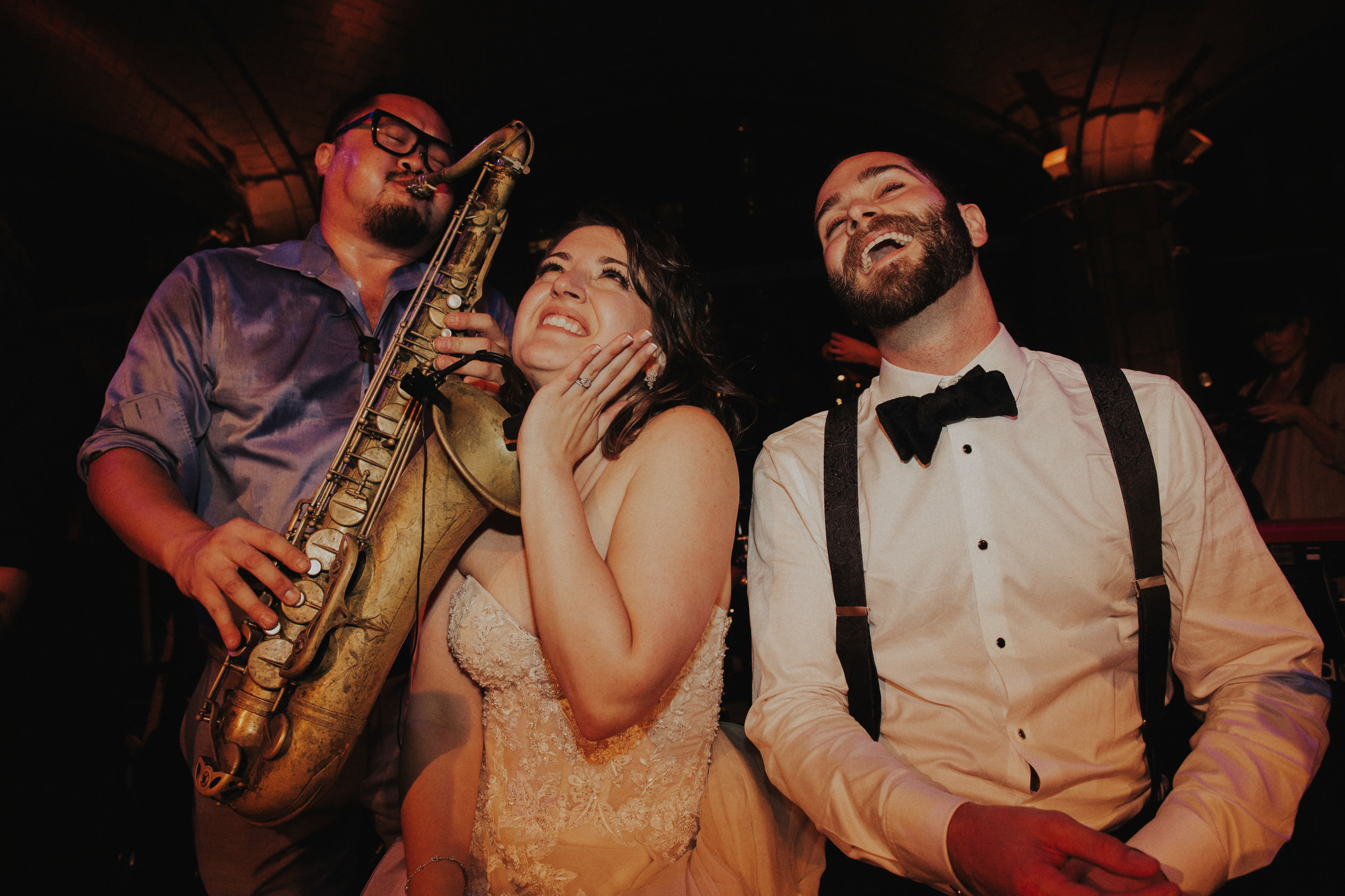 Bride and groom parting with saxaphone - photo by Dan O'Day