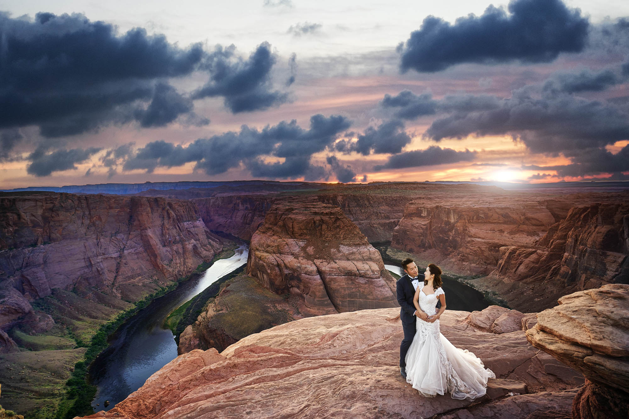 Bride and groom pose at Grand Canyon, photo by CM Leung