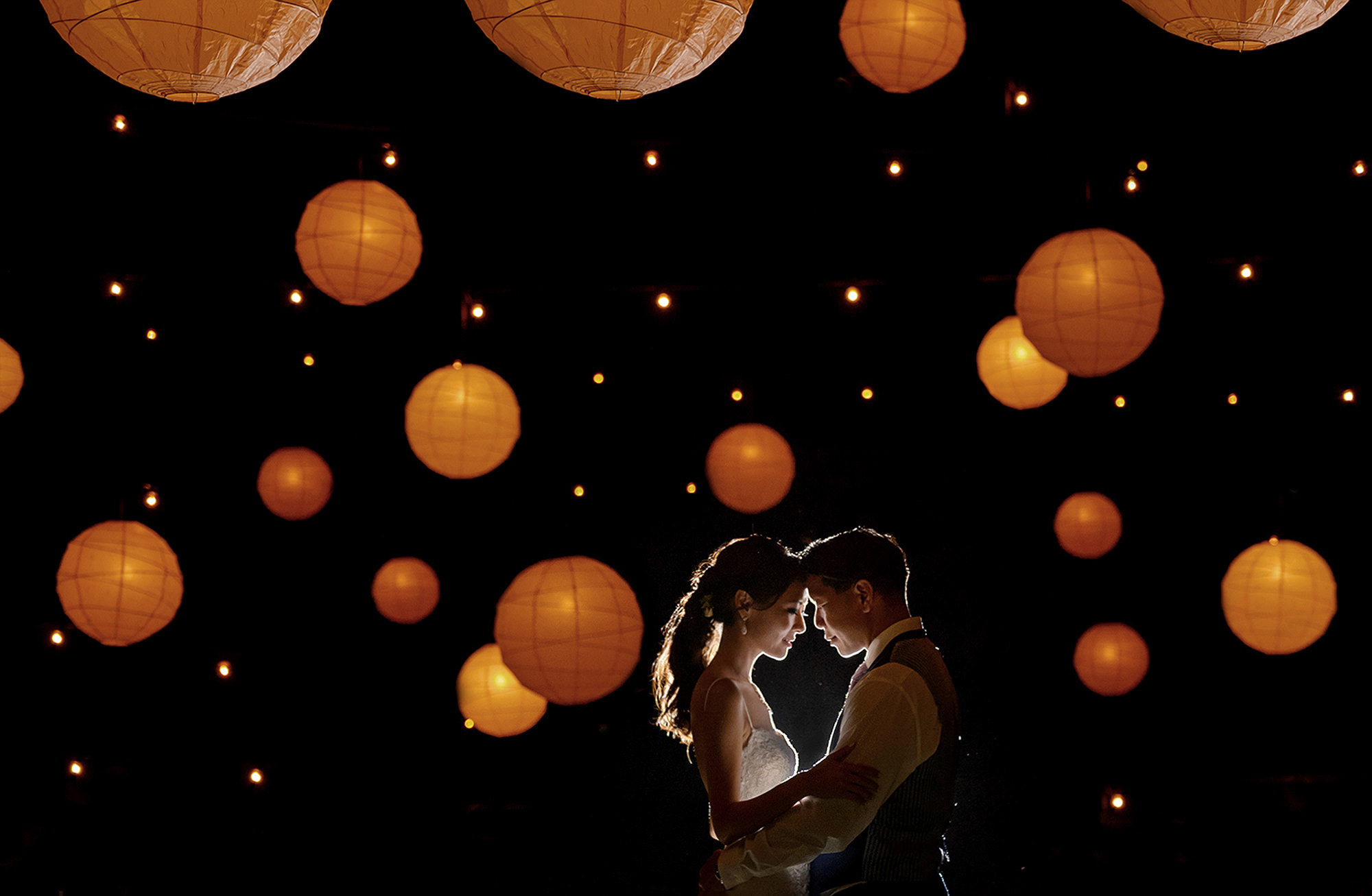 Bride and groom portrait with hanging globe lanterns, photo by 37 Frames, Japan Wedding Photographers