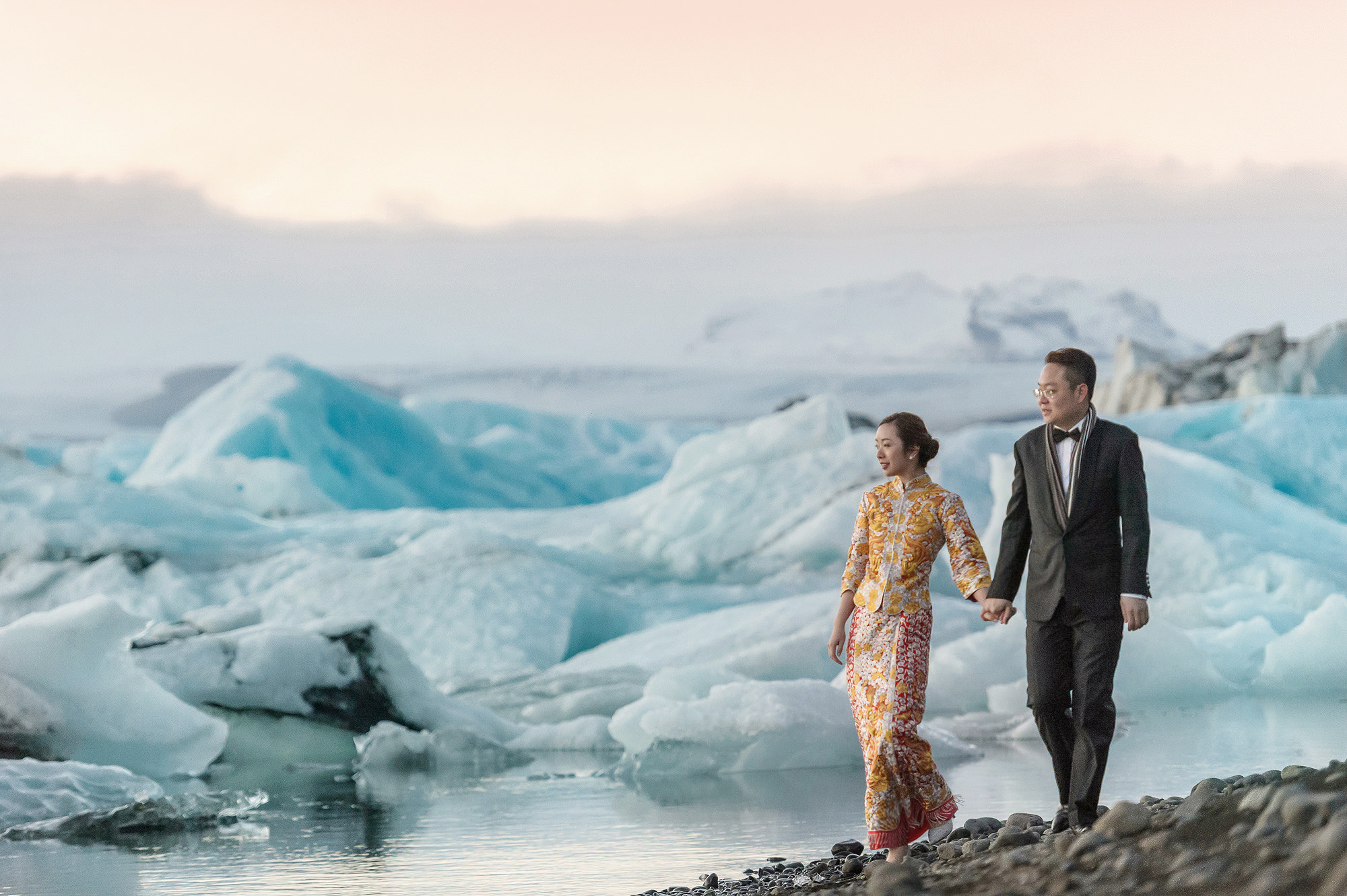 Bride and groom against sea of ice, photo by 37 Frames, Japan wedding photographers.