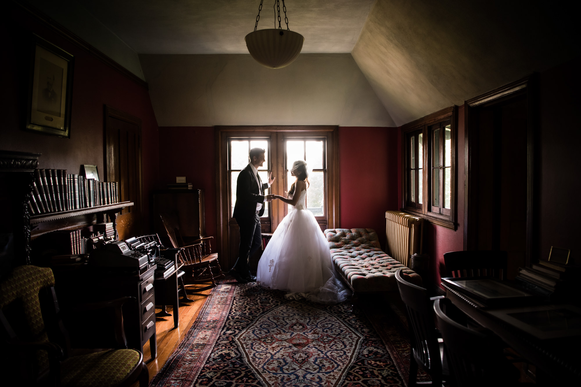 Couple profiles against windowlight by Cliff Mautner