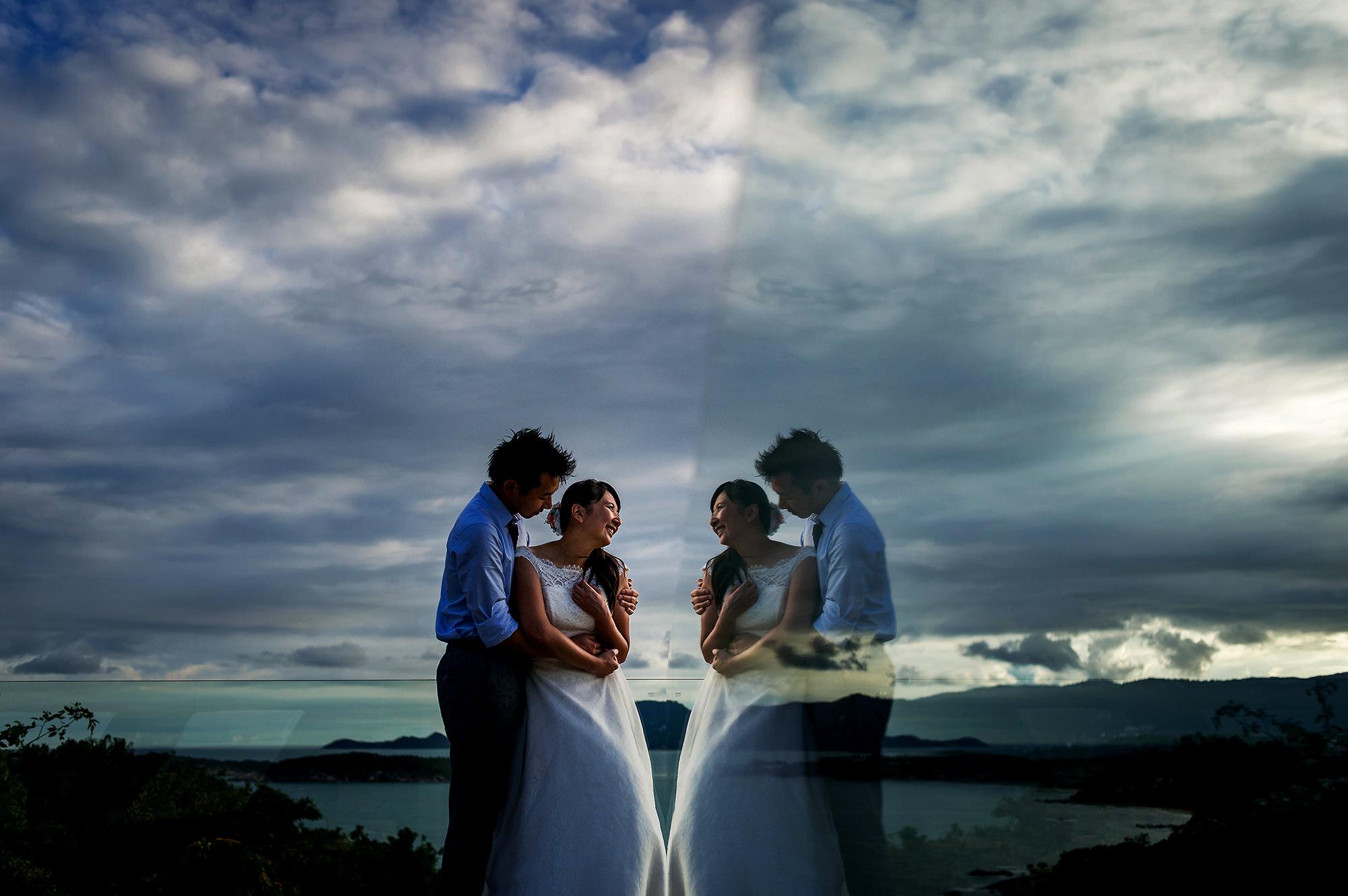 Portrait of bride and groom against lake, by Davina Plus Daniel
