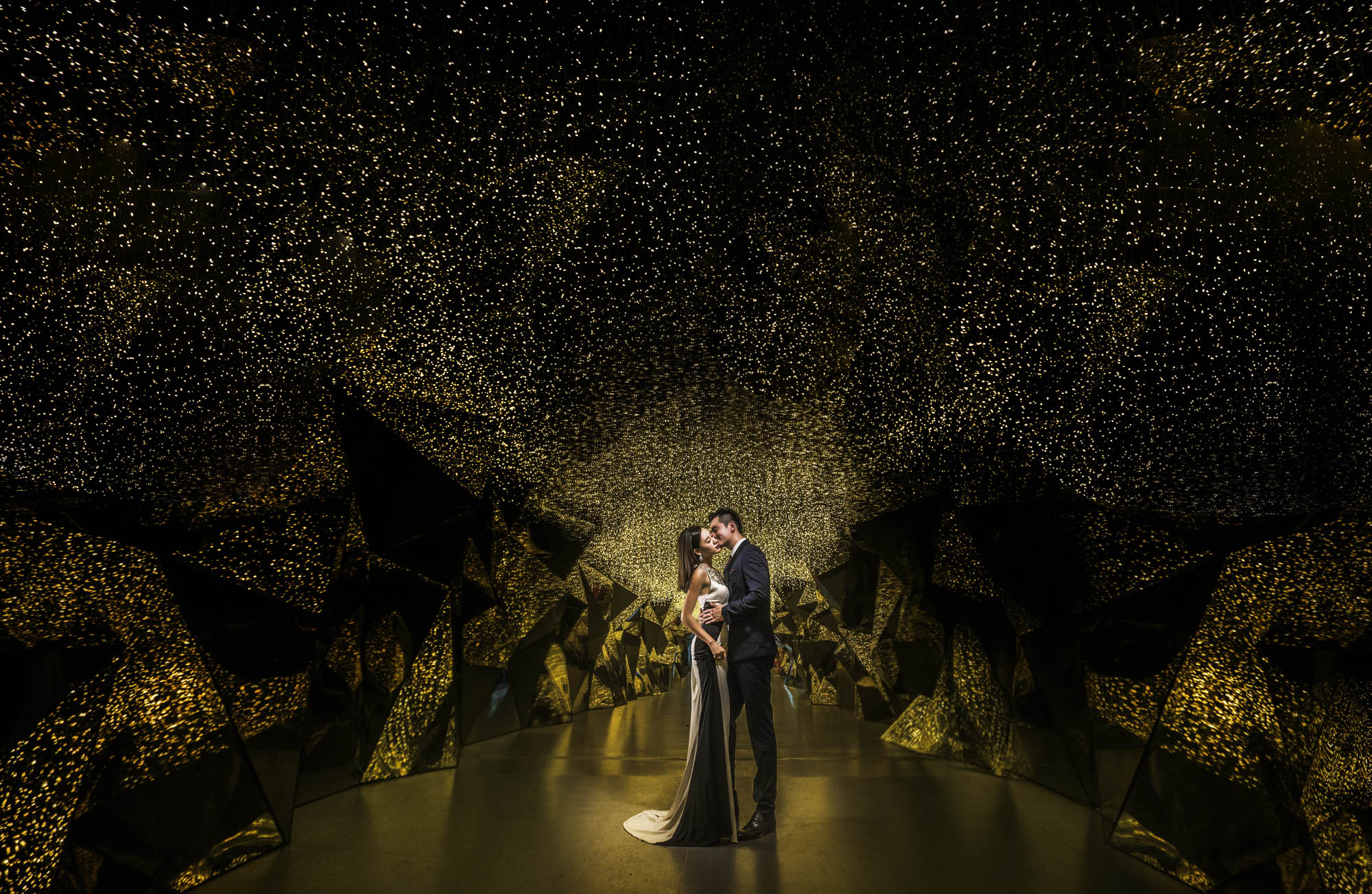 Bride and groom in epic gallery of twinkling fairy lights, by CM Leung