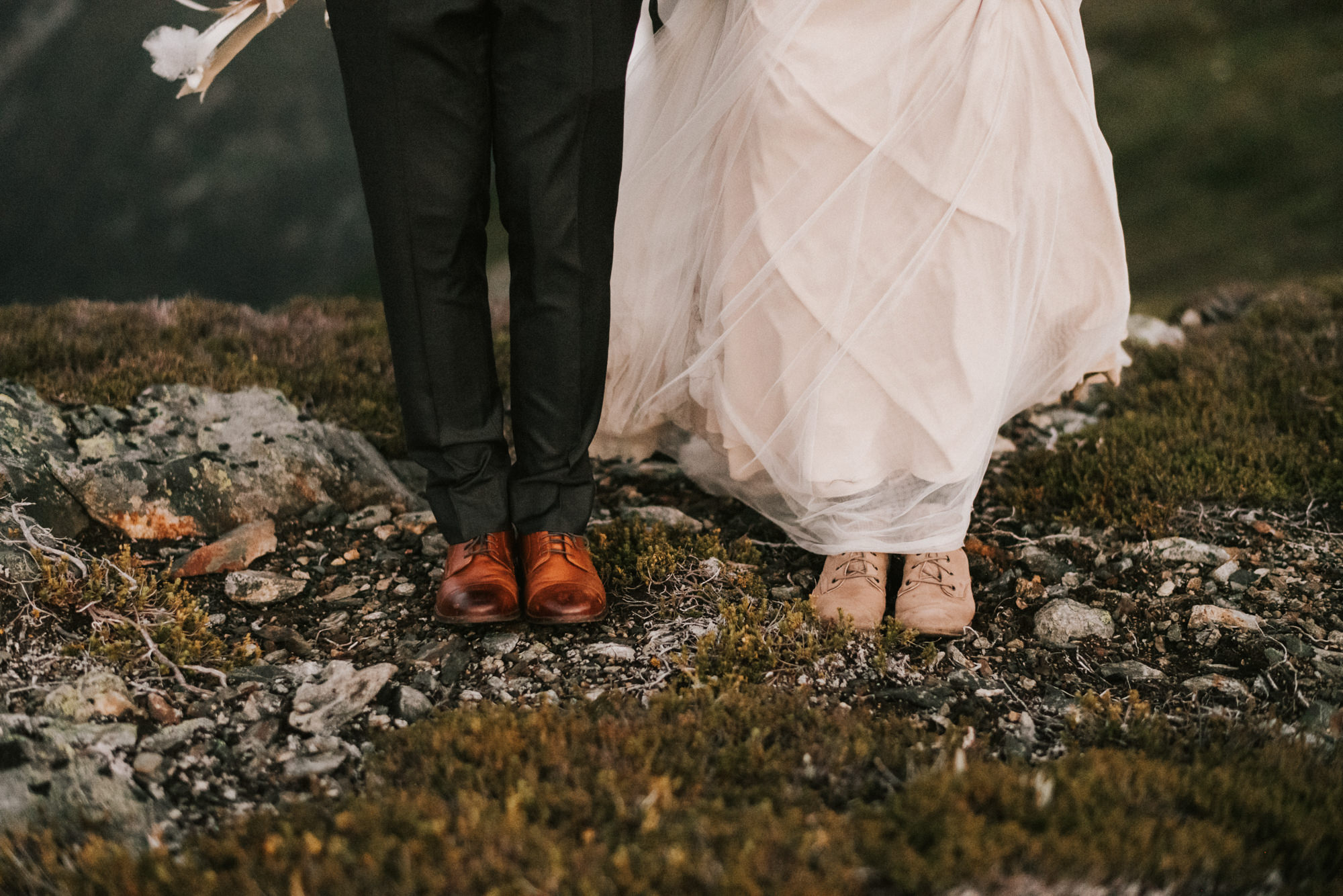 Bride and groom in rustic leather shoes - Nick + Danee