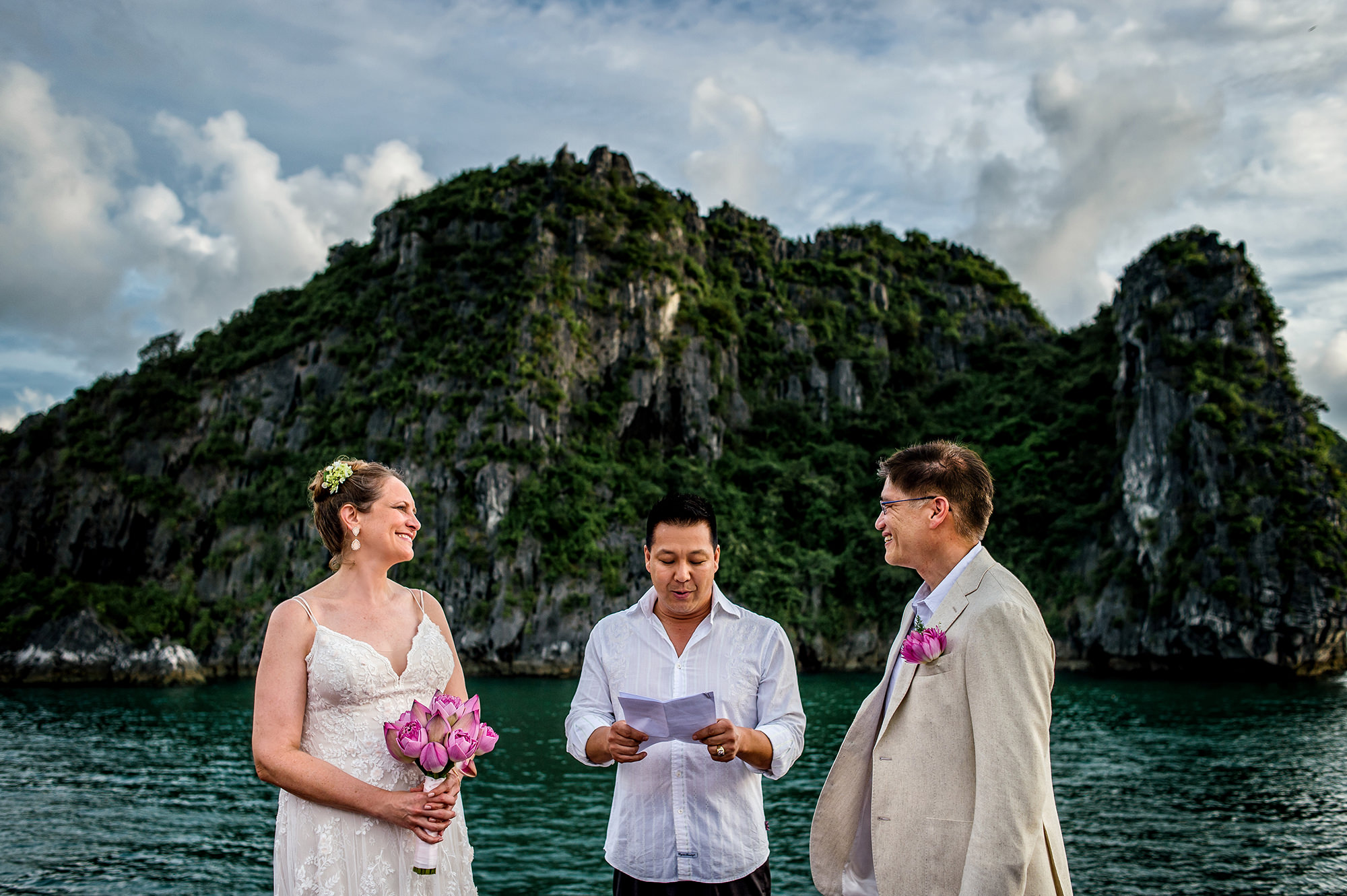 Elopement ceremony on waterfront South East Asia  - Davina + Daniel