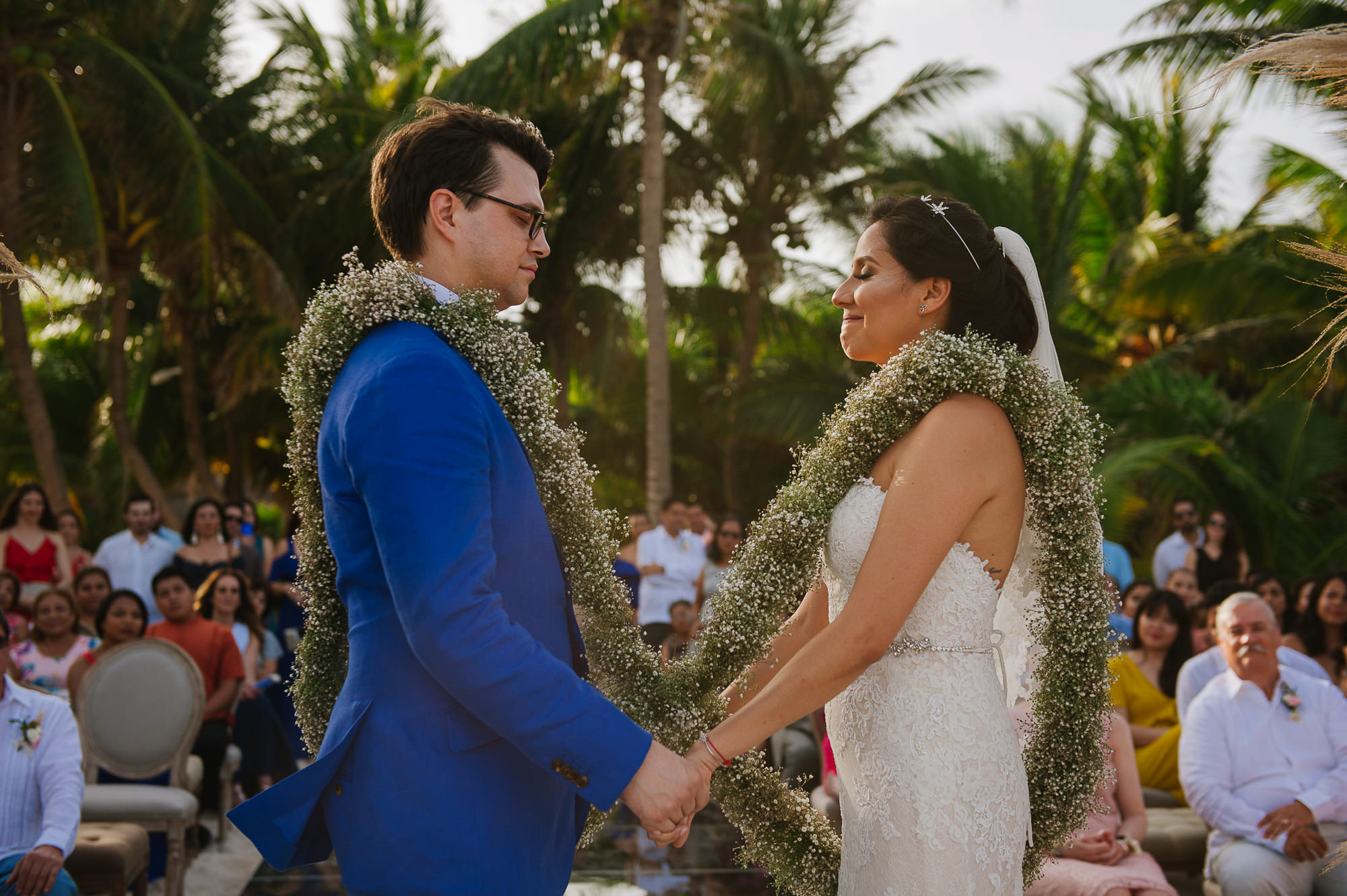 Bride and groom wearing baby's breath wreath together at ceremony, by Citlalli Rico