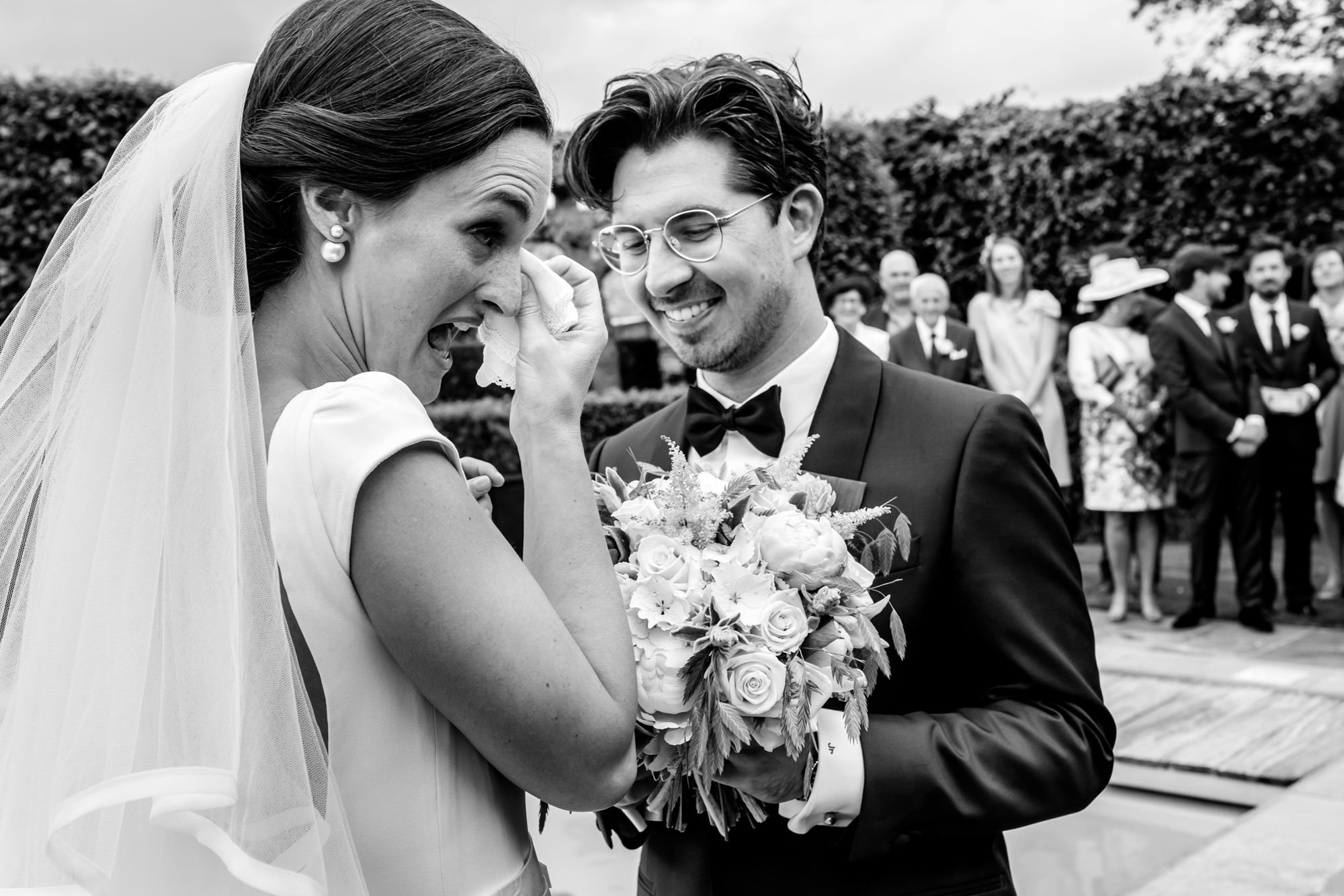 Bride wipes tears away during ceremony - photo by Philippe Swiggers