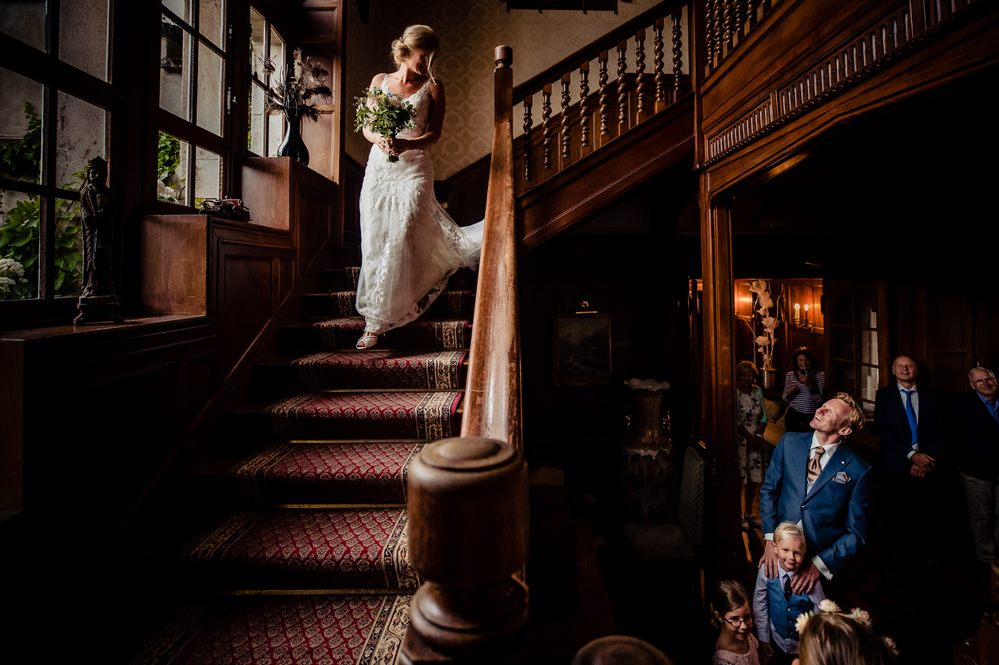 Bride descending stairs for first look, by Eppel Fotographie