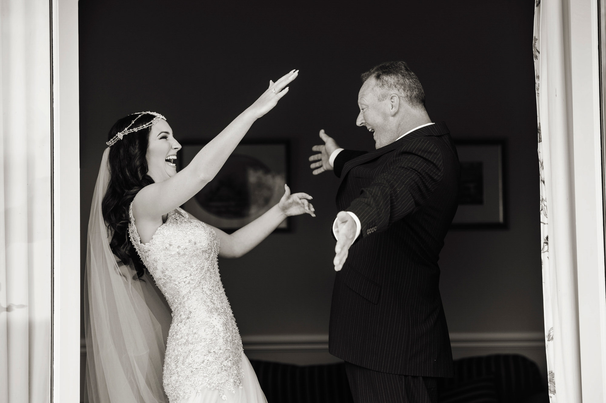 Bride embraces father at first look - photo by Jerry Ghionis