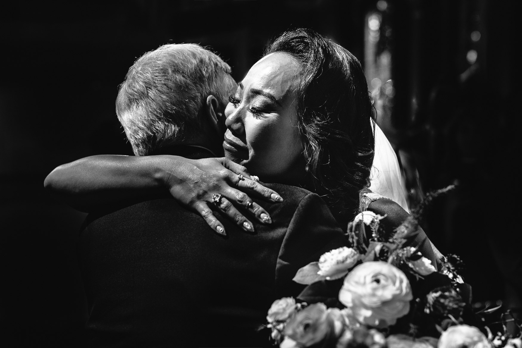 Emotional bride hugging dad, by Callaway Gable