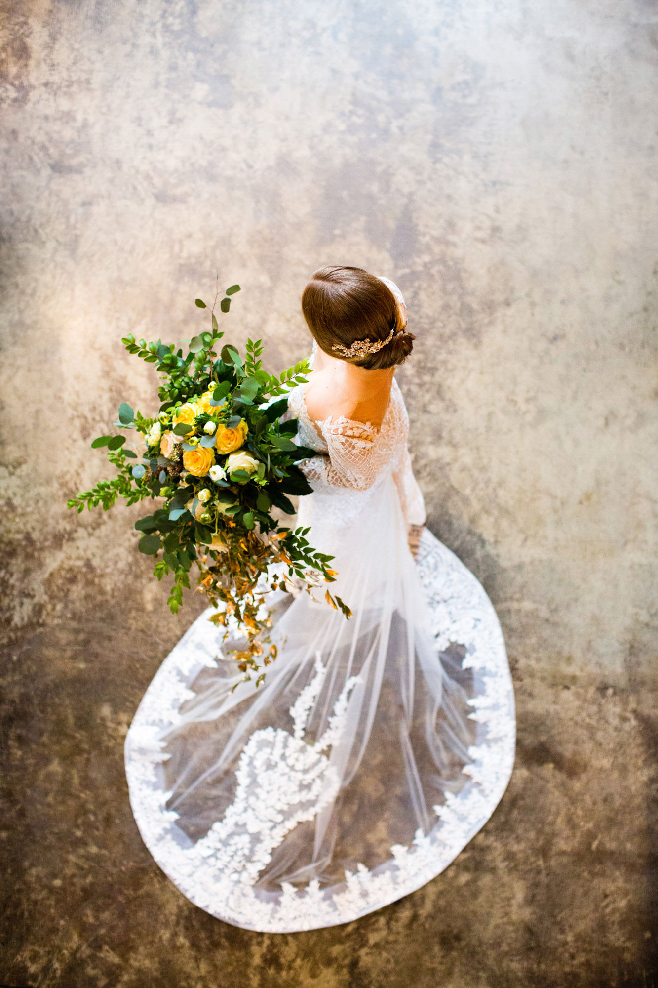 Bride with large bouquet of yellow rose in lace gown - La Vie Photography