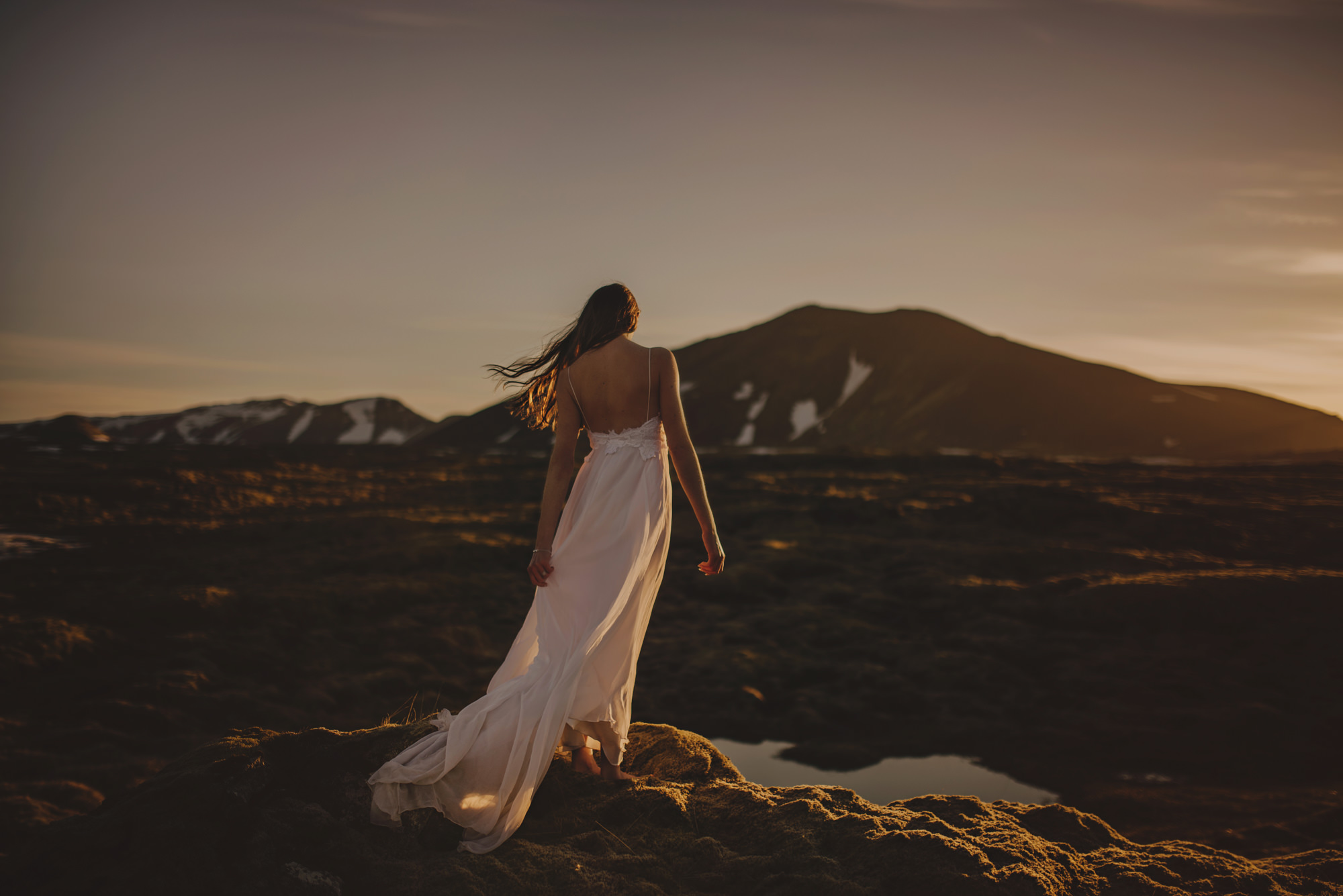 Bride from behind in backless dress - photo by McClintock Photography Agency