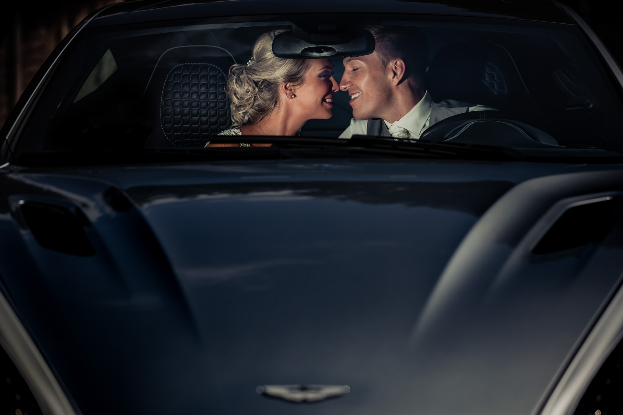Bride and groom in car by Eppel Fotographie