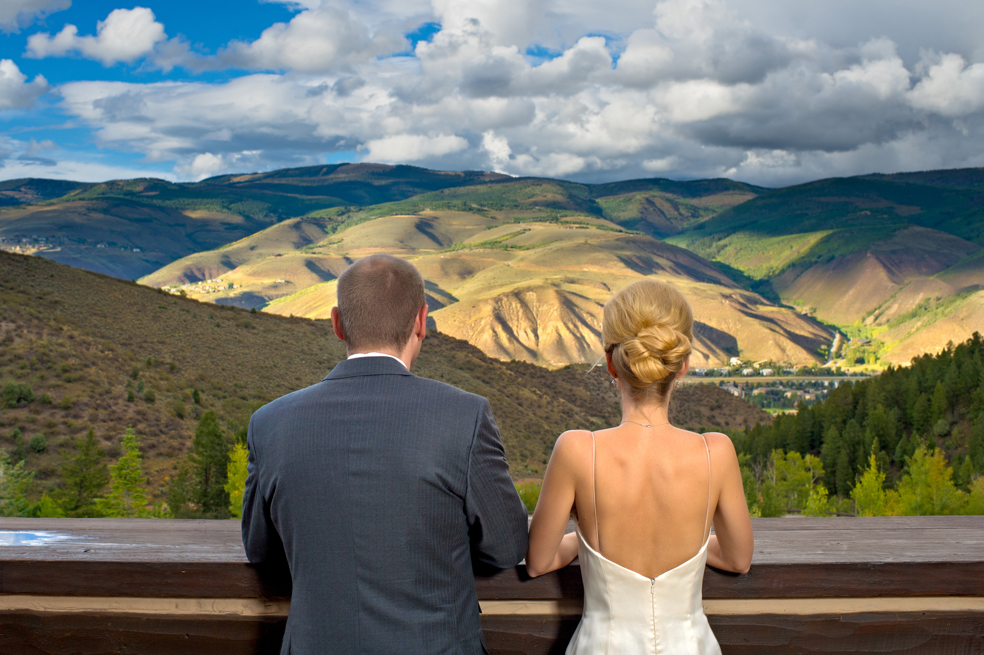Bride and groom look out over Nova Scotia landscape - photo by Cooked Photography